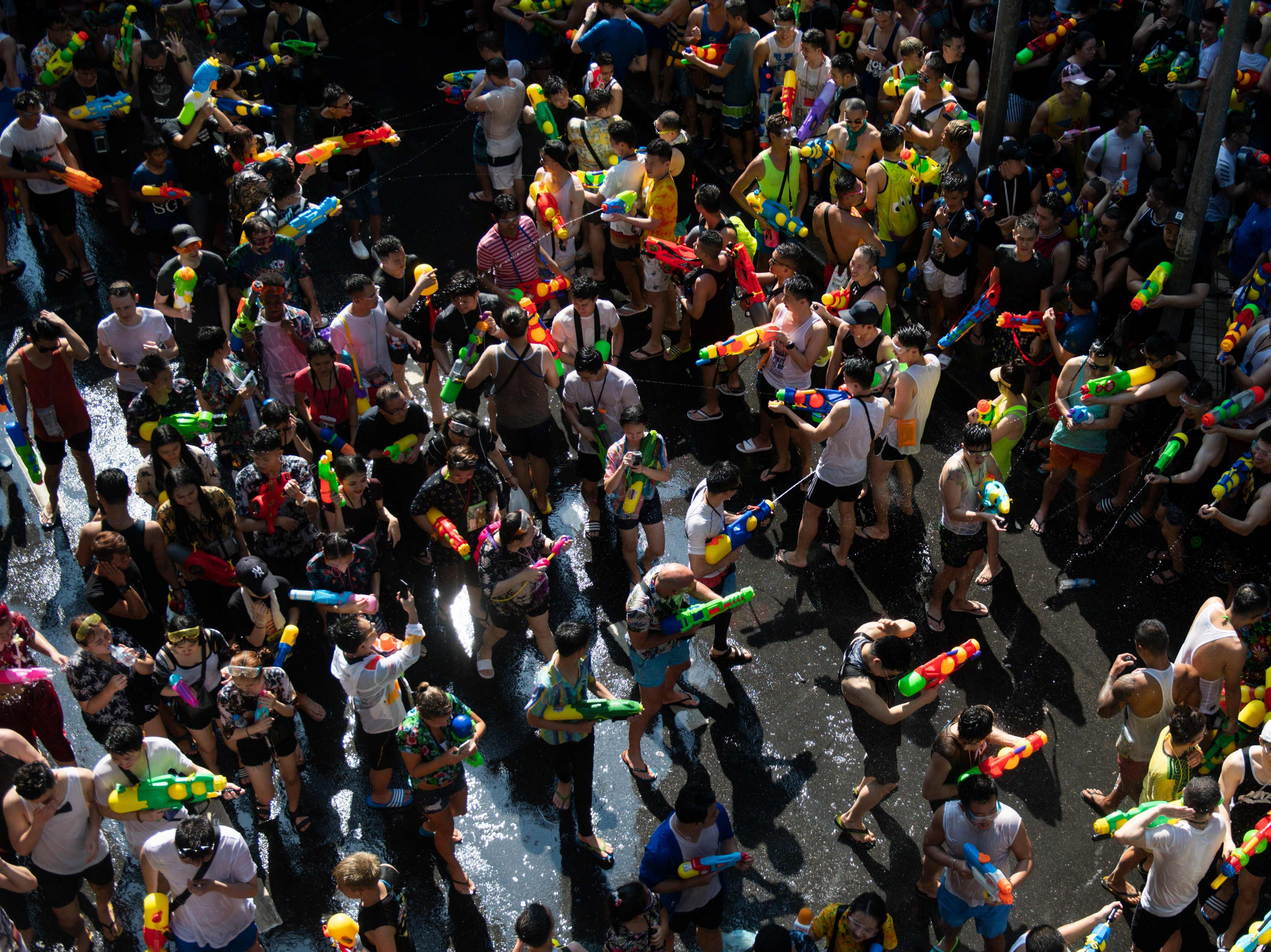 Revelers use water guns to spray at one another as they celebrate the Buddhist New Year, locally known as Songkran, in Bangkok, Thailand on April 13, 2019.