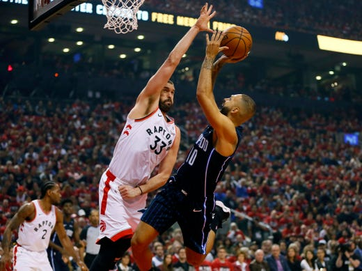 April 13: Raptors center Marc Gasol defends against Magic guard Evan Fournier during Game 1.