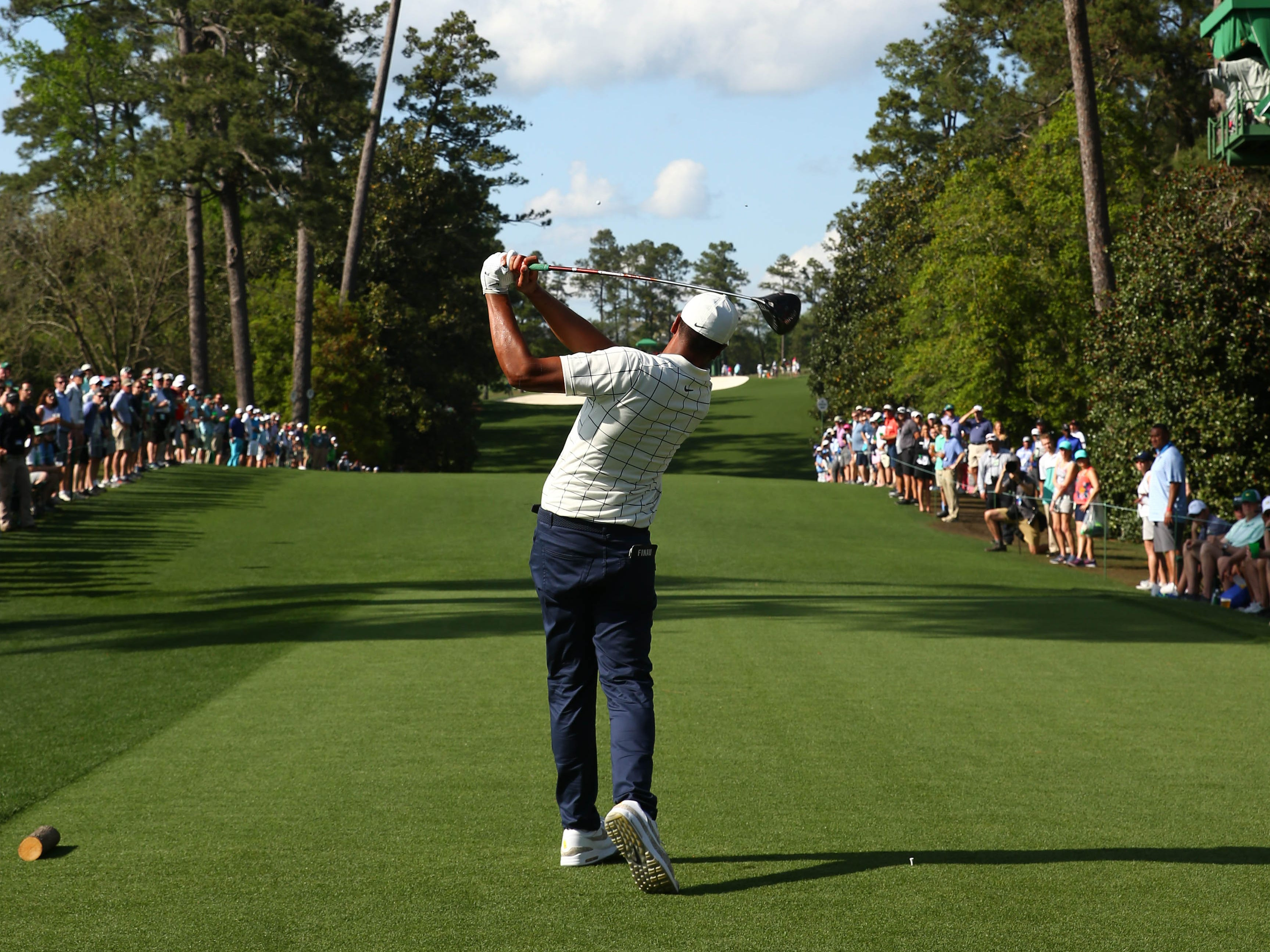 Tony Finau hits his tee shot on the 18th hole during the third round of the Masters.
