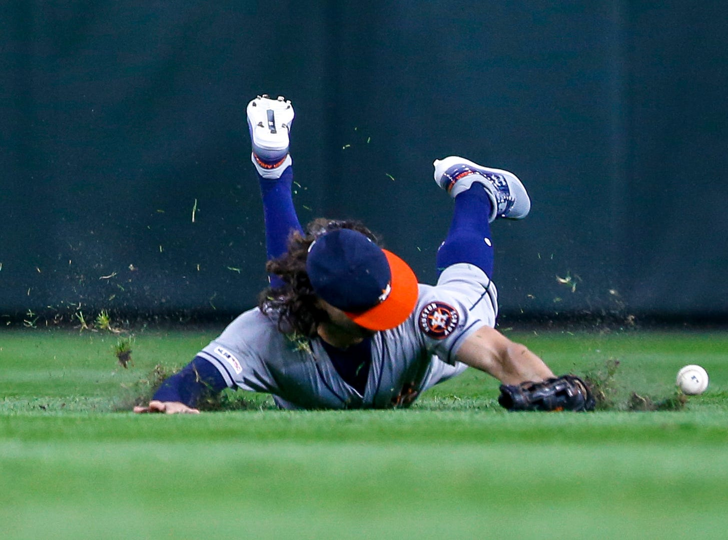 April 12: Houston Astros center fielder Jake Marisnick can't make the catch on a dive for a ball against the Seattle Mariners.