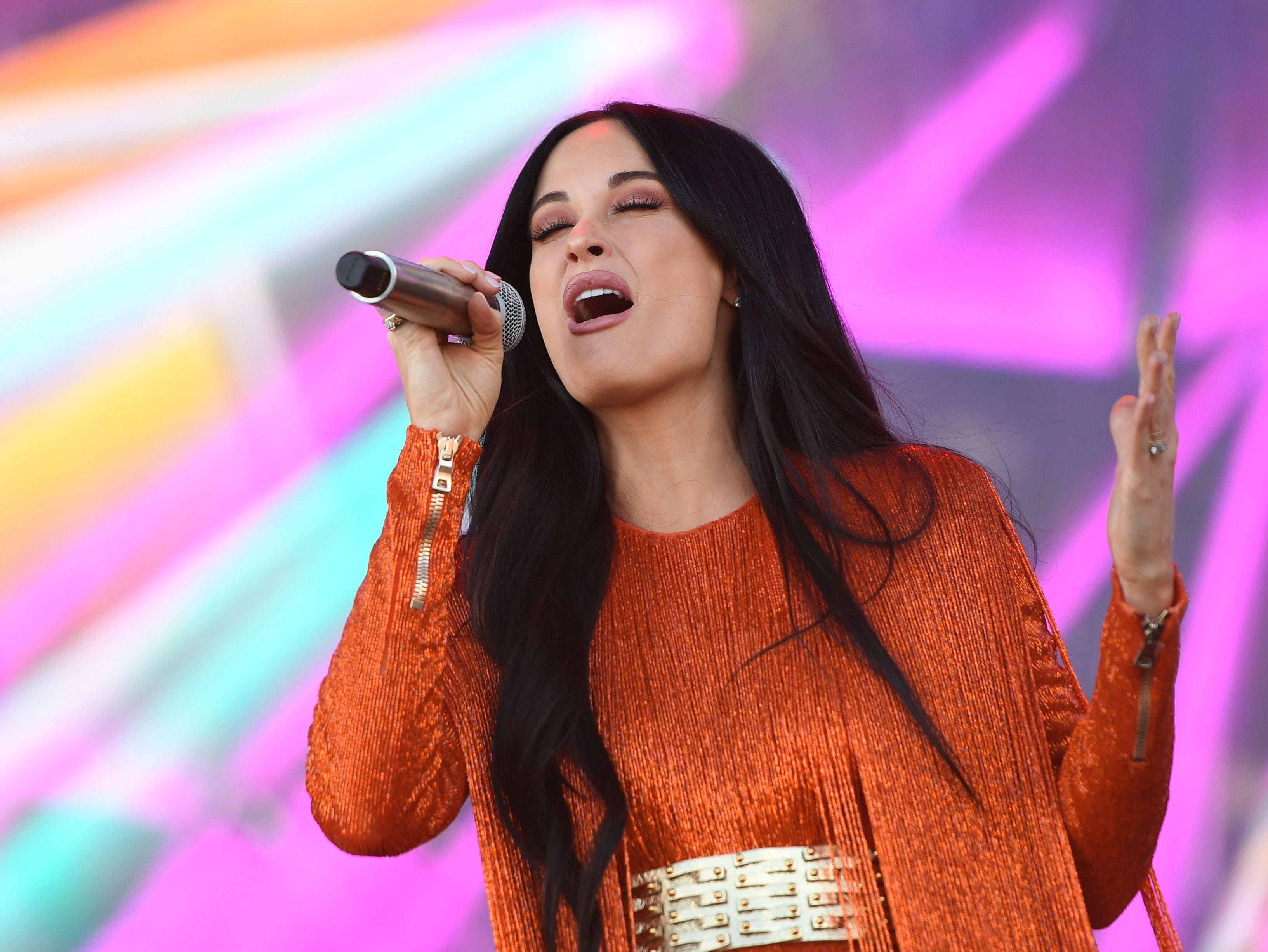 Singer/songwriter Kacey Musgraves performs on stage at Coachella Music Festival on April 12, 2019 in Indio, California. (Photo by VALERIE MACON / AFP)VALERIE MACON/AFP/Getty Images ORG XMIT: Ariana Gr ORIG FILE ID: AFP_1FM04D