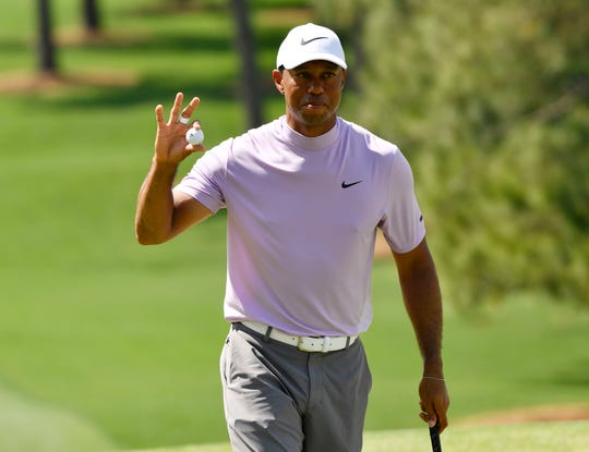 Tiger Woods reacts after making a birdie putt on the seventh hole during the third round of the Masters.