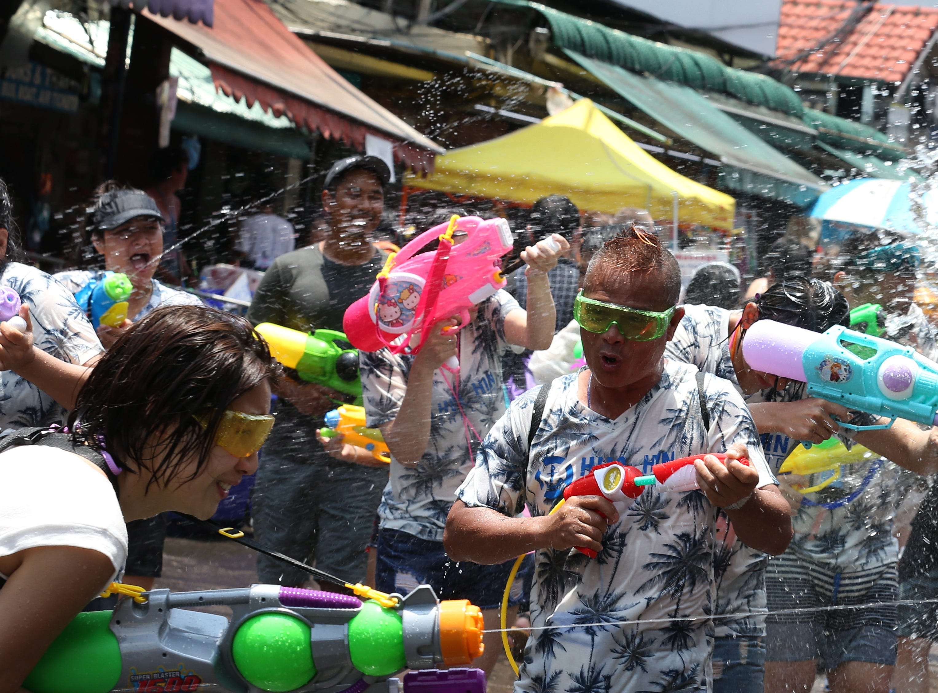 Foreign tourists join the Songkran Festival, the celebrations on Thai traditional New Year in Bangkok, Thailand on April 13, 2019.