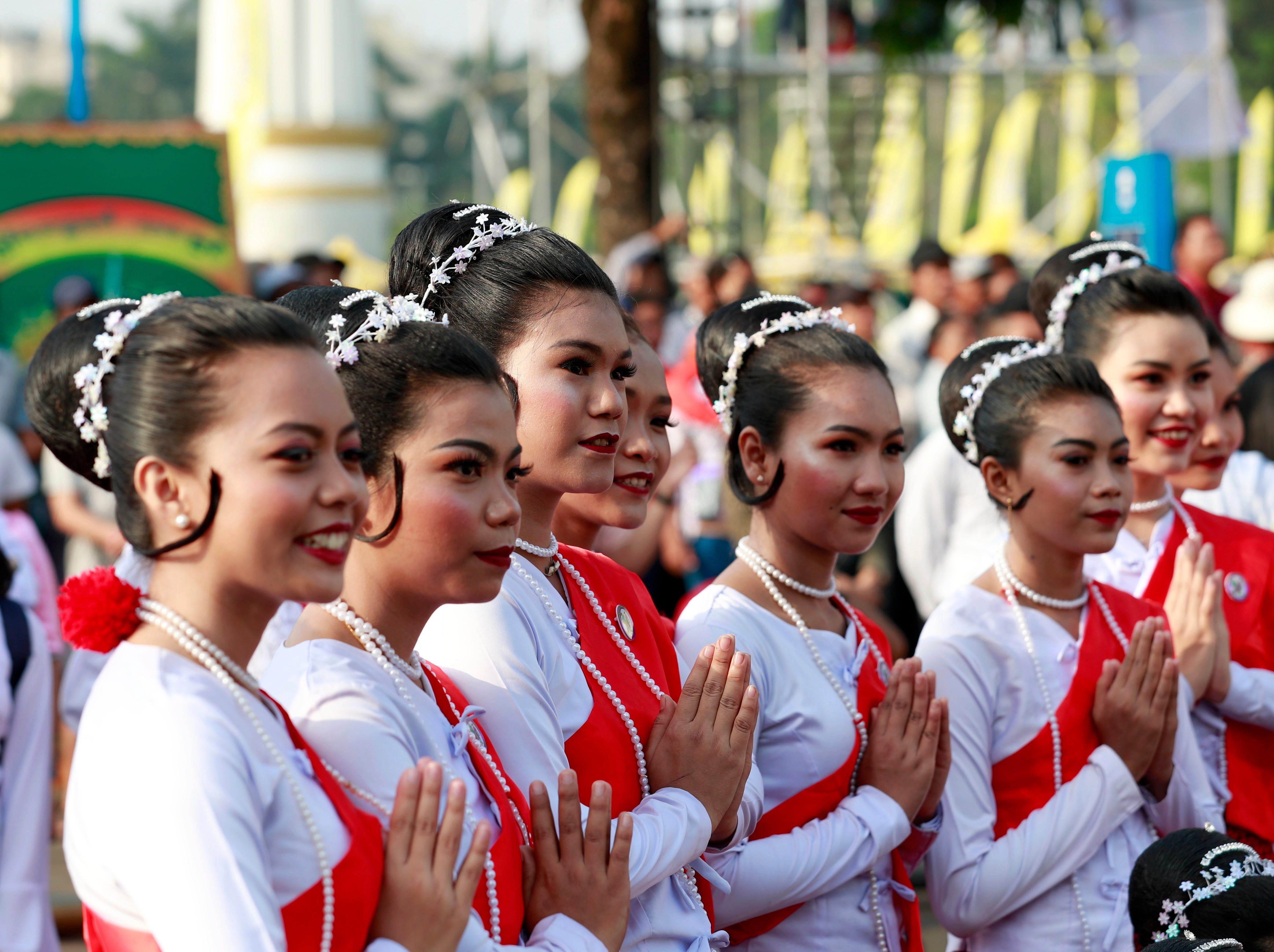 Mon ethnic women participate during the opening ceremony of the Thingyan Water Festival in Yangon, Myanmar.