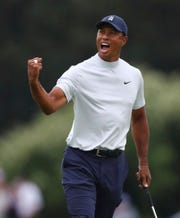Tiger Woods reacts to his birdie putt on 15 during the second round of the Masters.