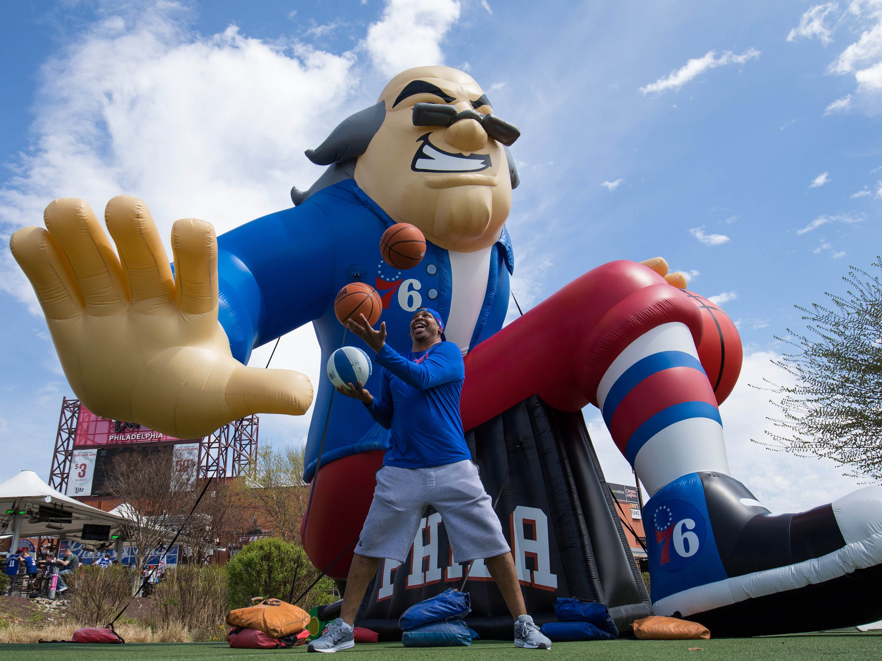 April 13: Delaware Blue Coats ambassador of basketball Joe Richmond juggles balls in front of a giant inflatable of Ben Franklin  before Game 1 of the first-round series between the 76ers and the Nets.