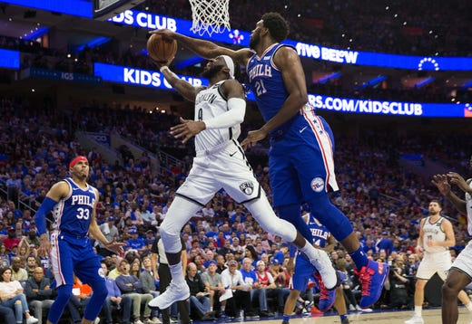 April 13: 76ers center Joel Embiid blocks the shot attempt of Nets forward DeMarre Carroll in Game 1.