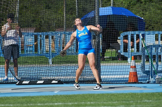 Alyssa Wilson throws the discus for UCLA in March