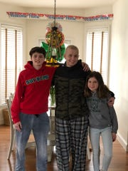 Ryan Shaughnessy (center) with his brother Aidan (left) and sister Avery (right)