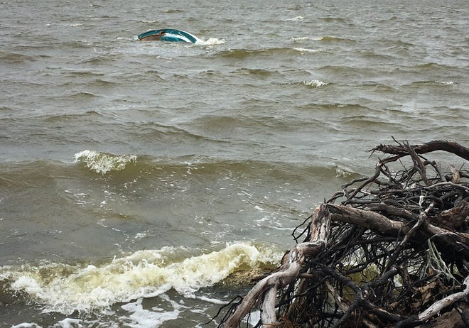 Four people managed to make it to shore Sunday after a 20-foot boat capsized in choppy waves on the Banana River.