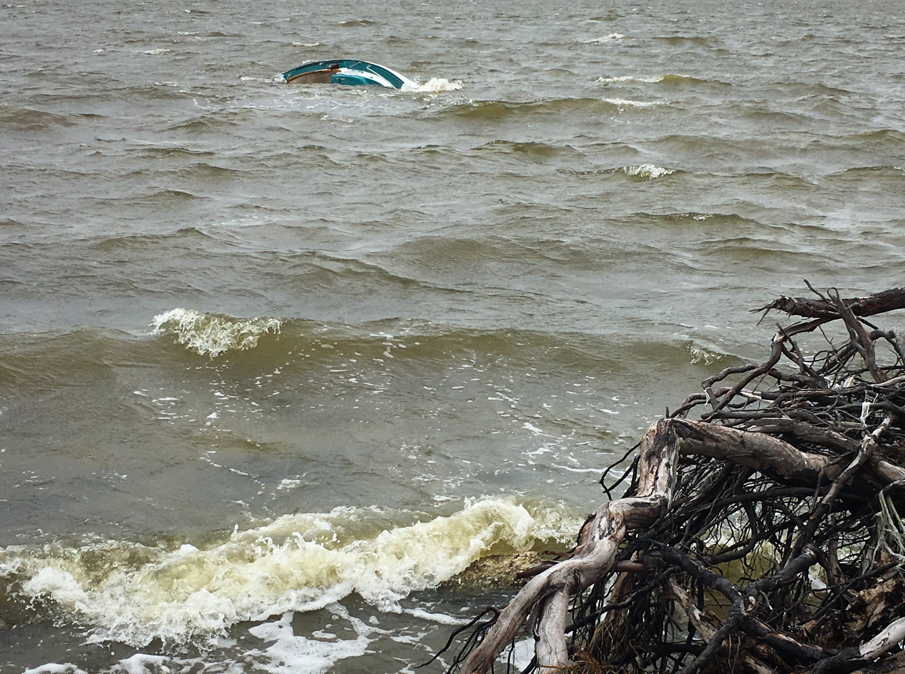 Four people managed to make it to shore Sunday, April 14, 2019, after a 20-foot boat capsized in the Banana River.