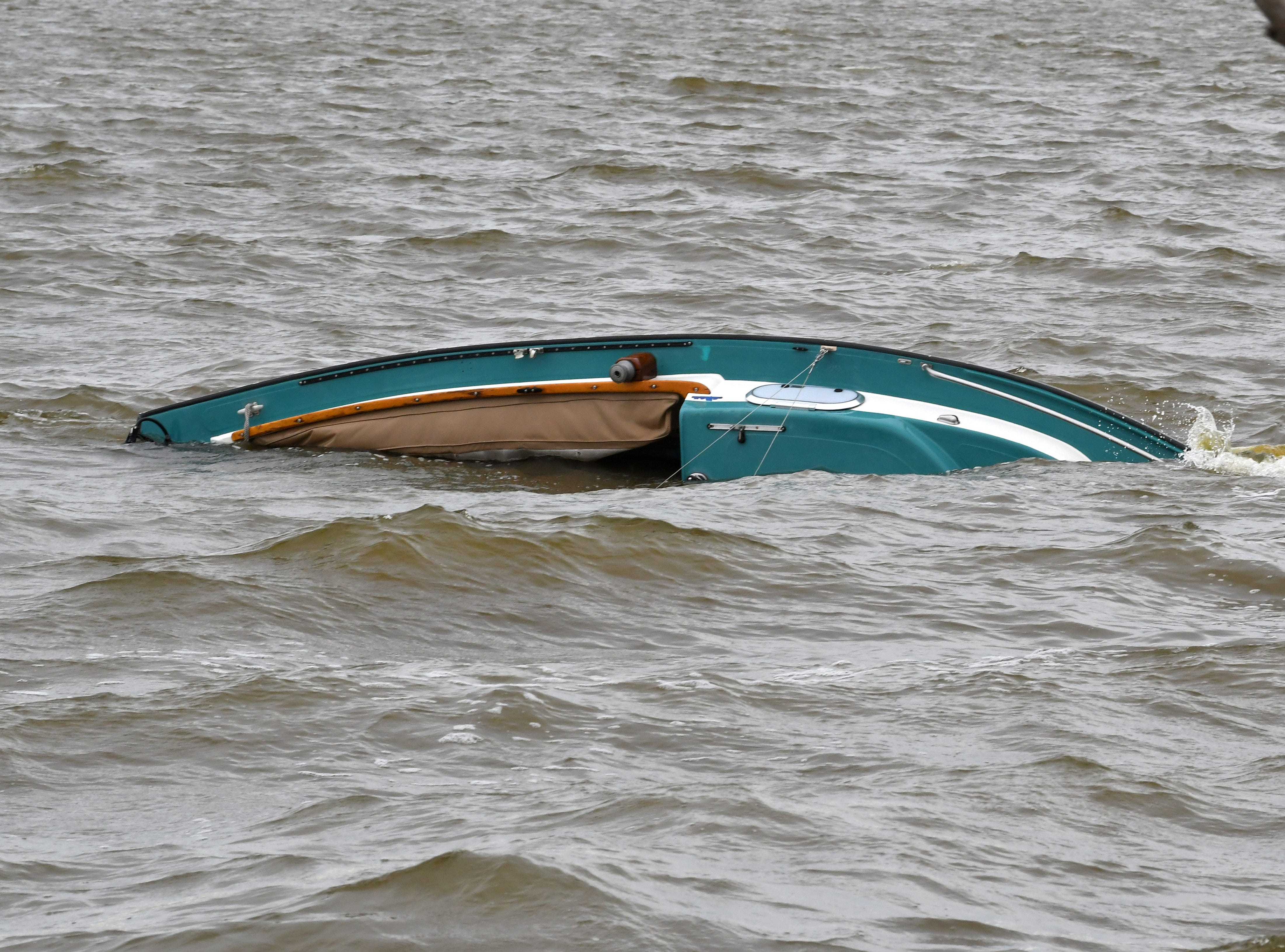 A 20-foot sailboat overturned  in the Banana River near Merritt island ion Sunday. All four men aboard were rescued and uninjured. The capsized craft drifted closer to shore near State Road 528.