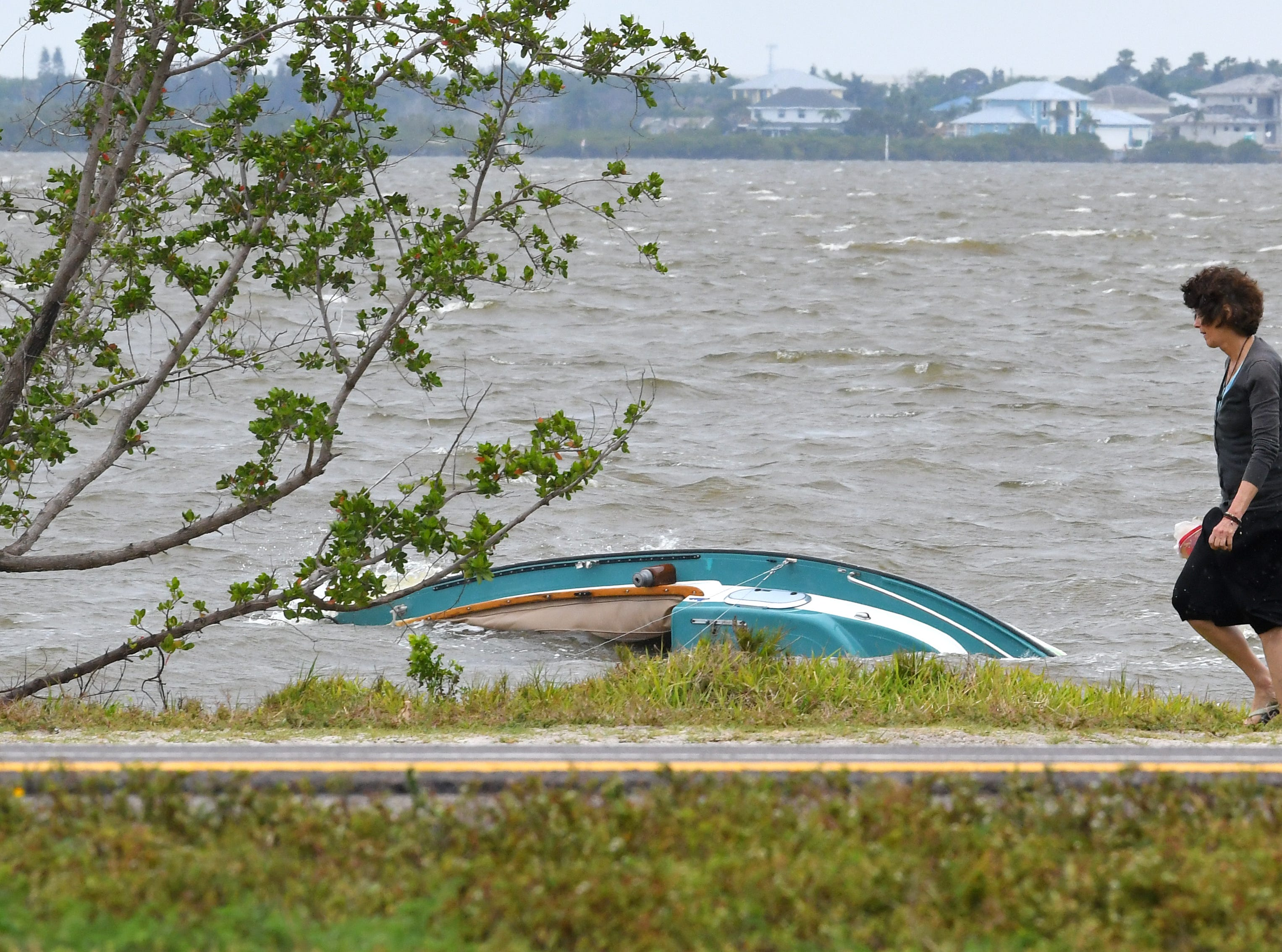 The capsized craft drifted closer to shore near State Road 528.
