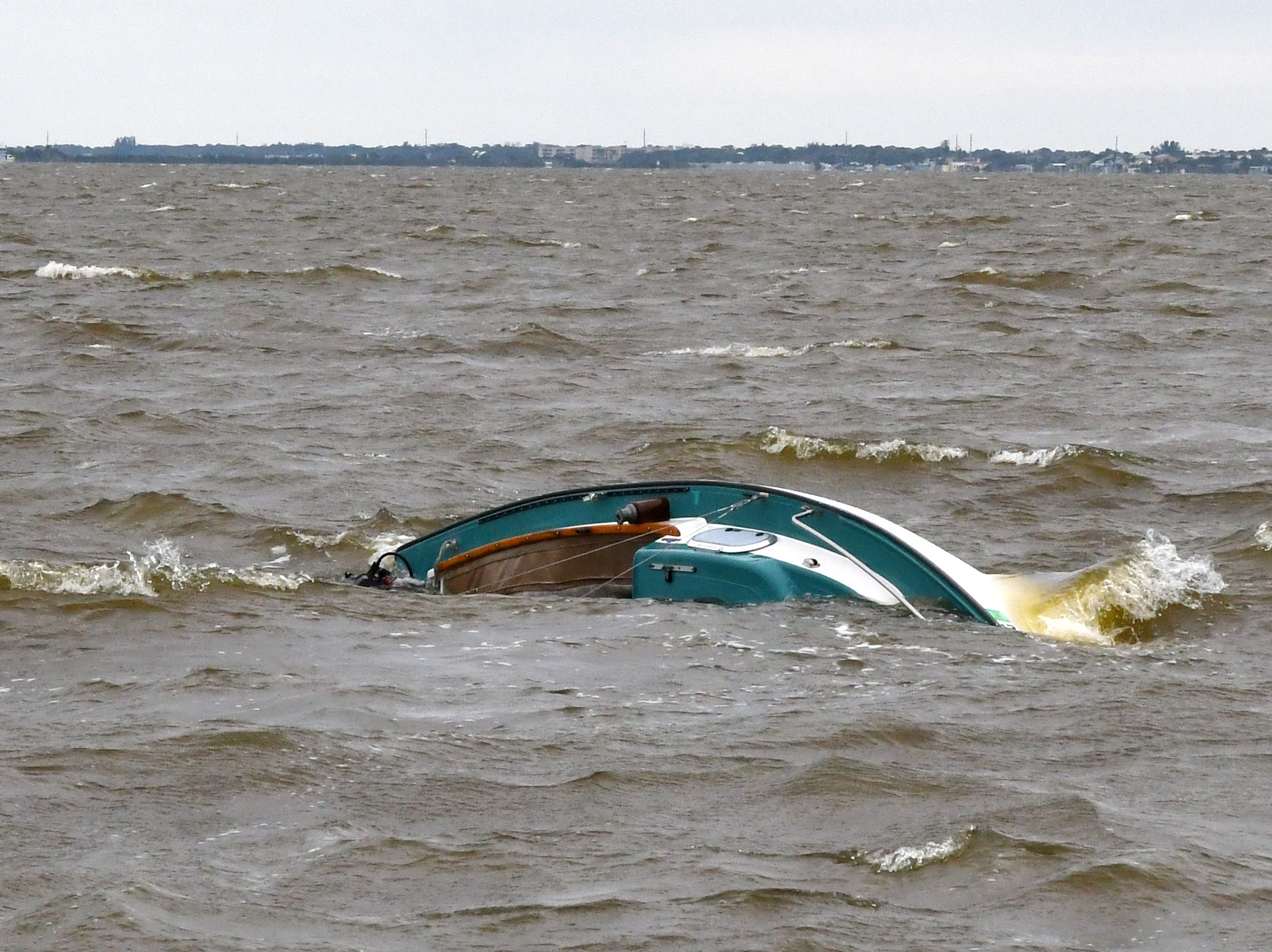 A 20 foot sailboat overturned  in the Banana River near Merritt island on Sunday, April 14, 2019.  Four men were rescued and uninjured. The capsized craft drifted closer to shore near State Road 528.