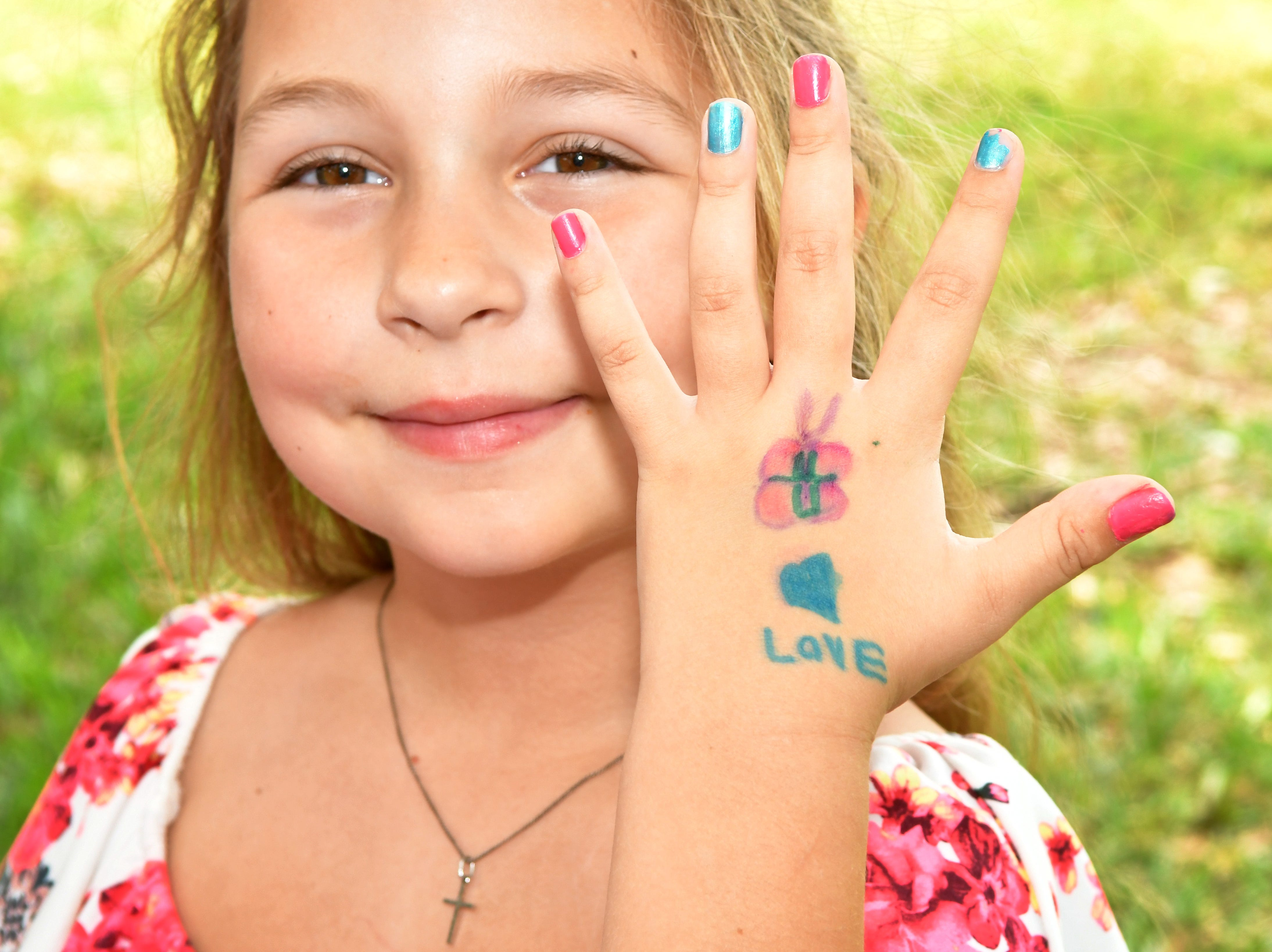 Addison Harris, 6, painted her nails and drew a message of love on her hand. Eastminster Presbyterian Church held a free Palm Sunday Funday following a traditional morning service. Activities included several animals from Cox Farms, Jazz music by the Ron Teixeira Trio, crafts, food, egg hunts, and  more. This Indialantic church, which is over 75 years old, will hold several series on Easter Sunday.