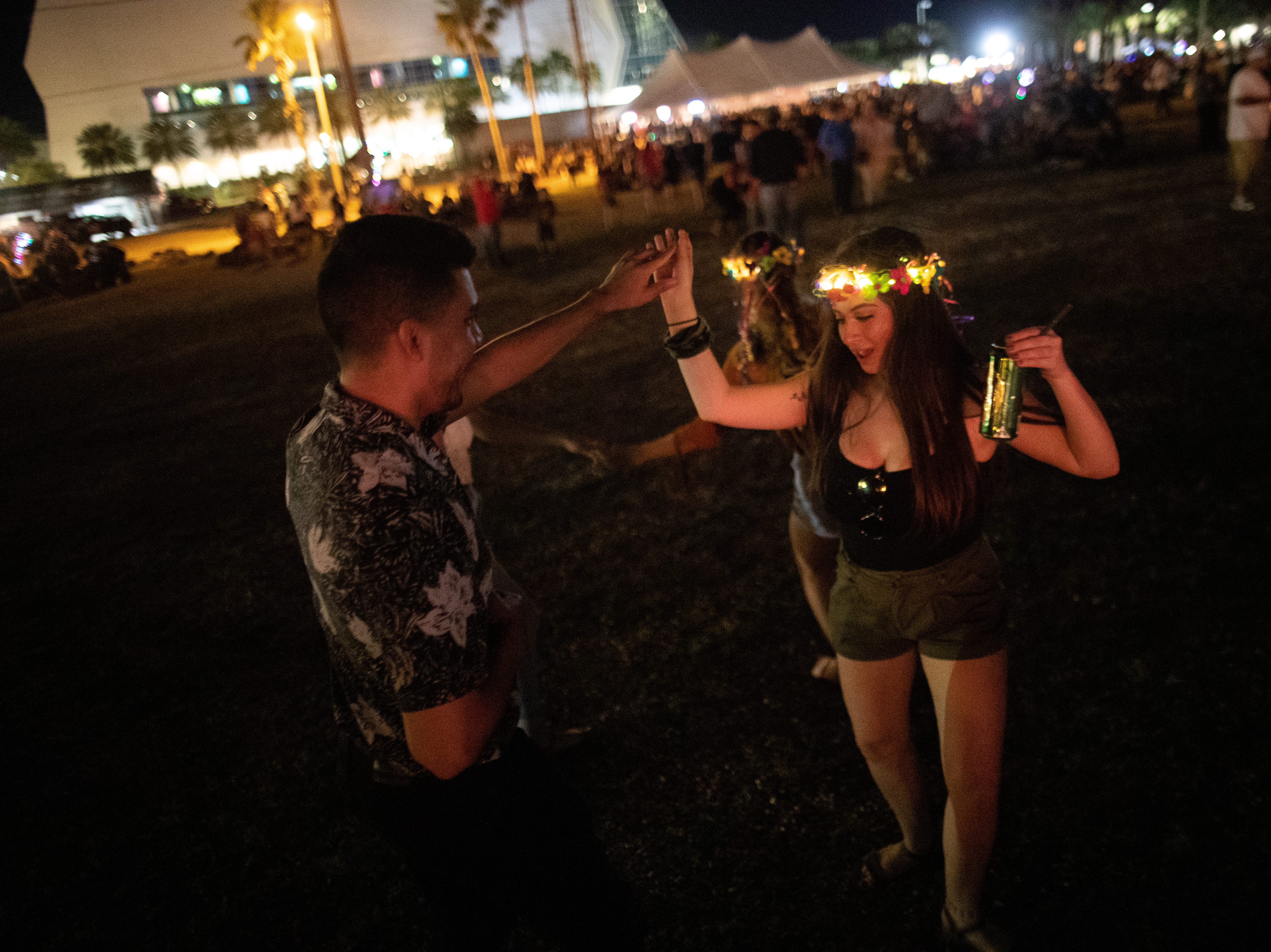 People dance during Eruck Y Su Grupo Massore's during the second day of Fiesta de la Flor on Saturday, April 13, 2019.
