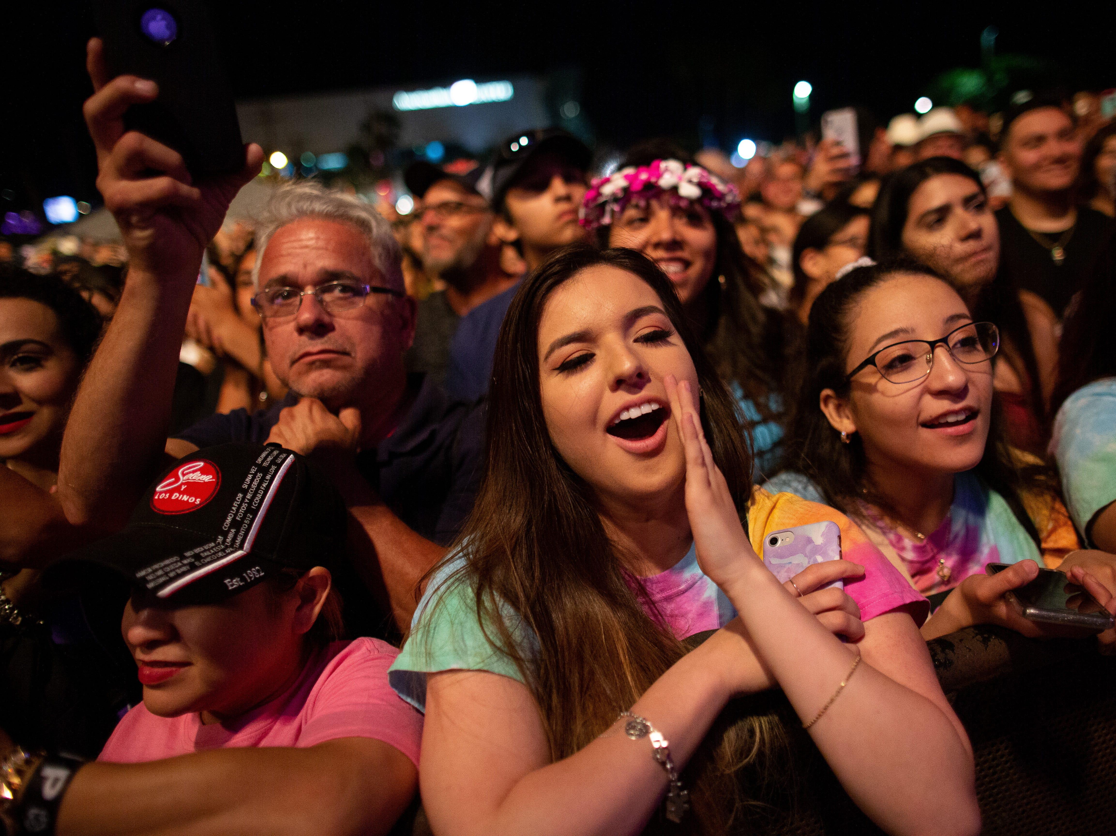 Fans cheer as Leslie Grace preform during the second day of Fiesta de la Flor on Saturday, April 13, 2019.