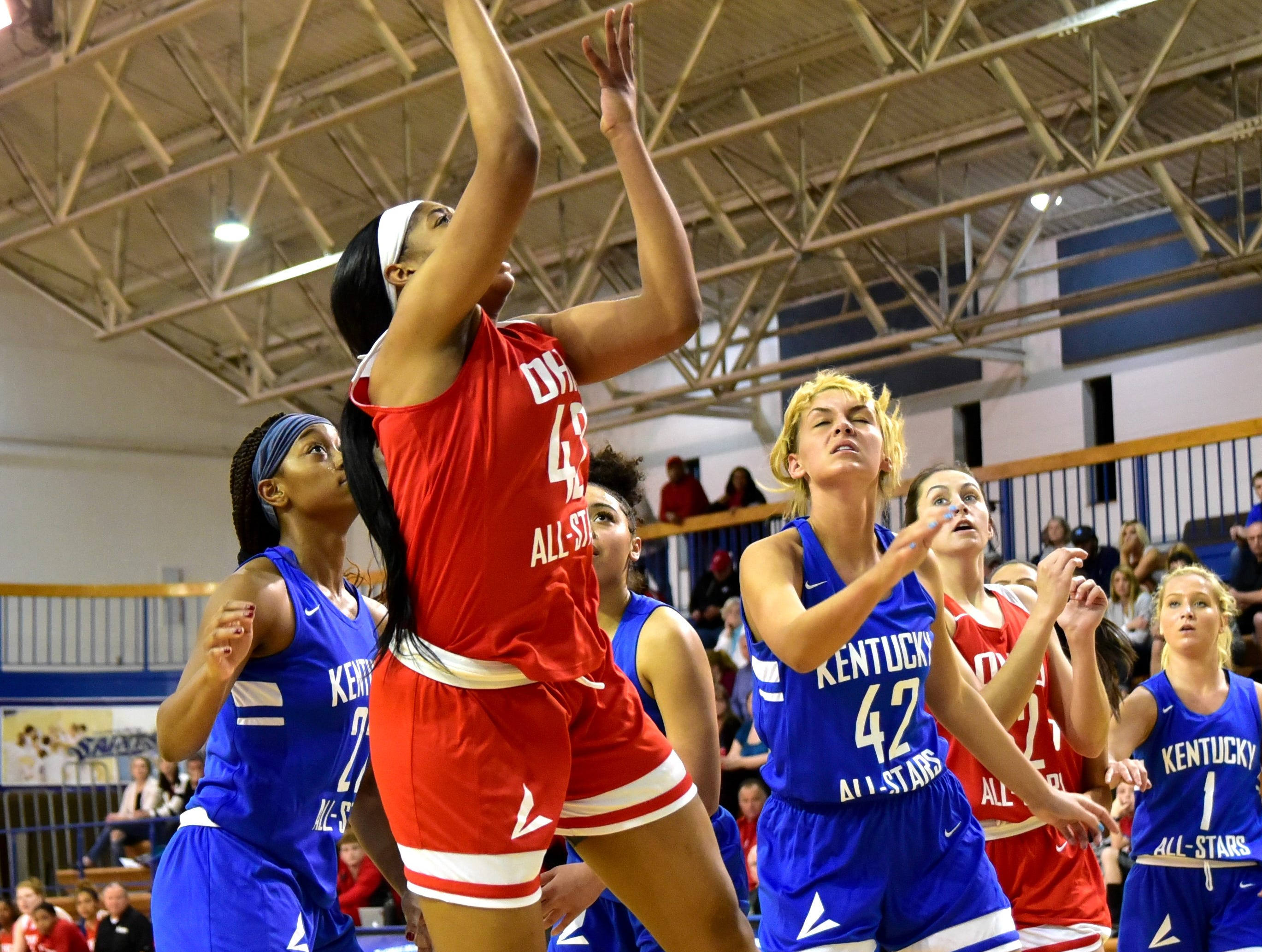 Kennedi Myles of Walnut Hills puts up a short jump shot for the Ohio girls team at the 28th Annual Ohio-Kentucky All Star Games played at Thomas More University, April 13, 2019