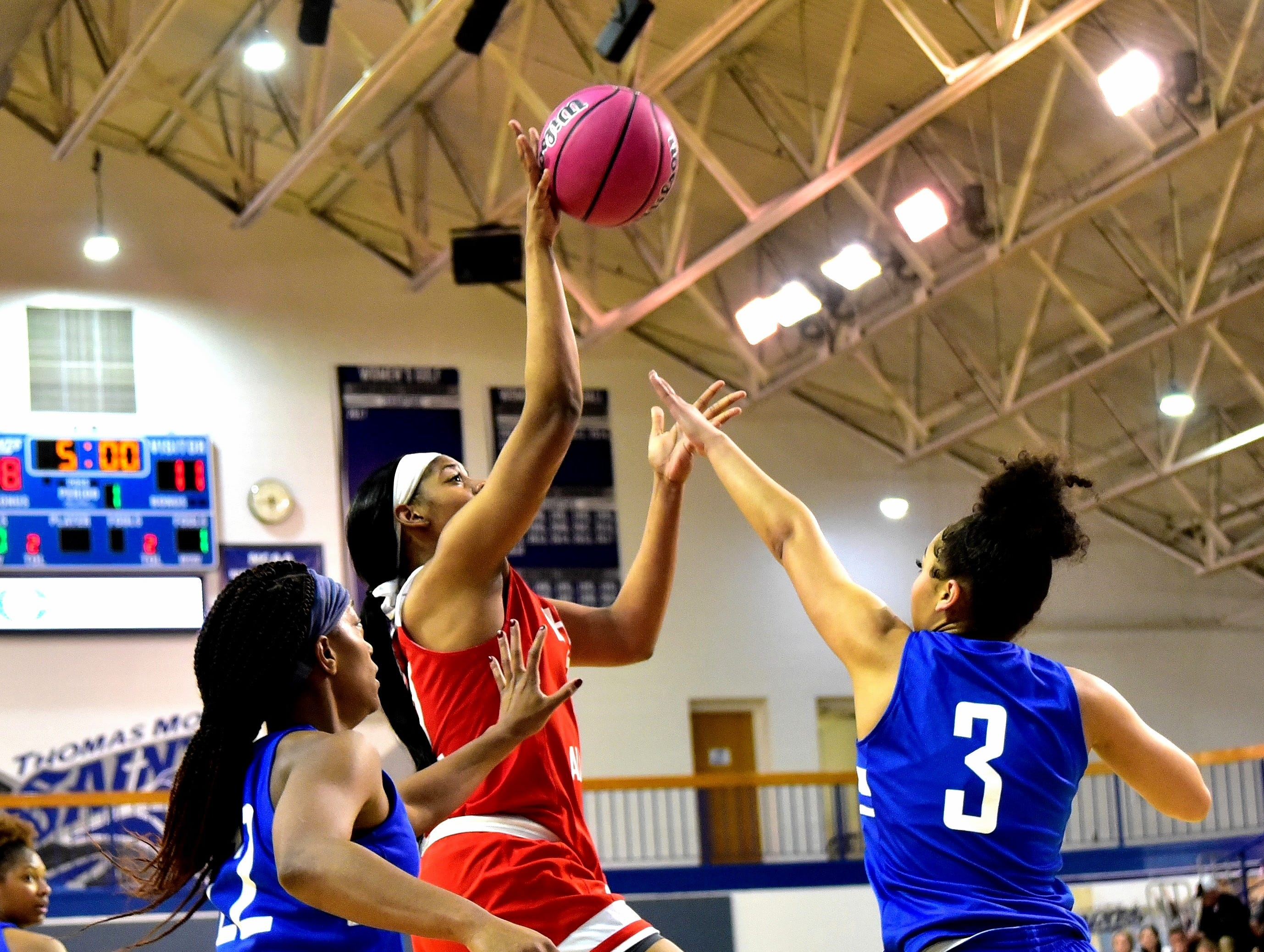 Kennedi Myles of Walnut Hills lofts a floater to the basket for the Ohio girls team at the 28th Annual Ohio-Kentucky All Star Games played at Thomas More University, April 13, 2019