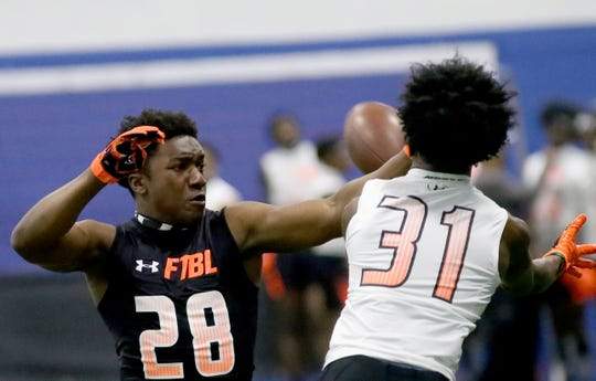 Winton Woods MiQuan Grace plays pass defense during the Under Armour All-American Camp in Cincinnati, Sunday, April 14, 2019.