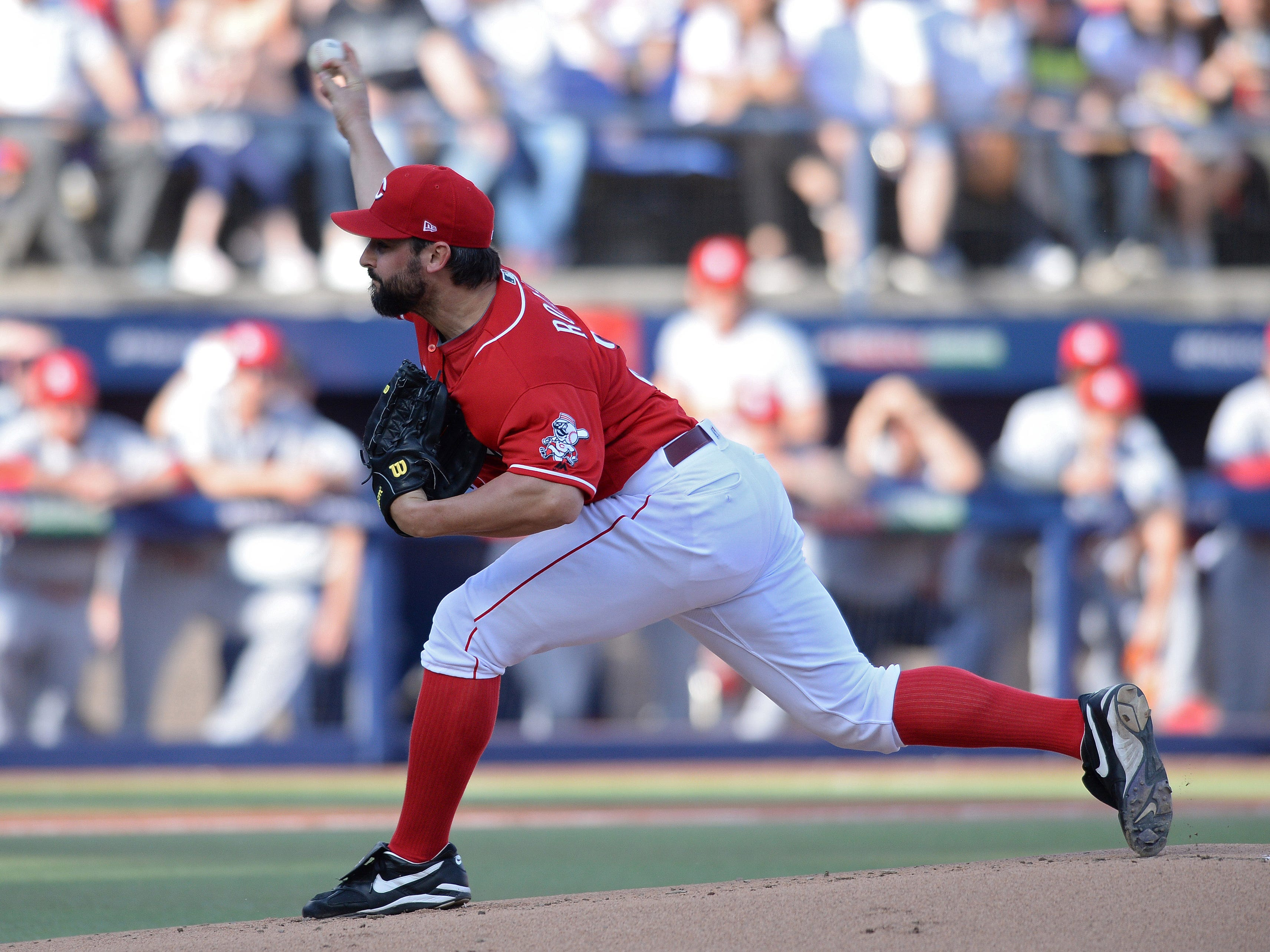 Cincinnati Reds starting pitcher Tanner Roark works against a St. Louis Cardinals batter during the first inning at Estadio de Beisbol Monterrey.