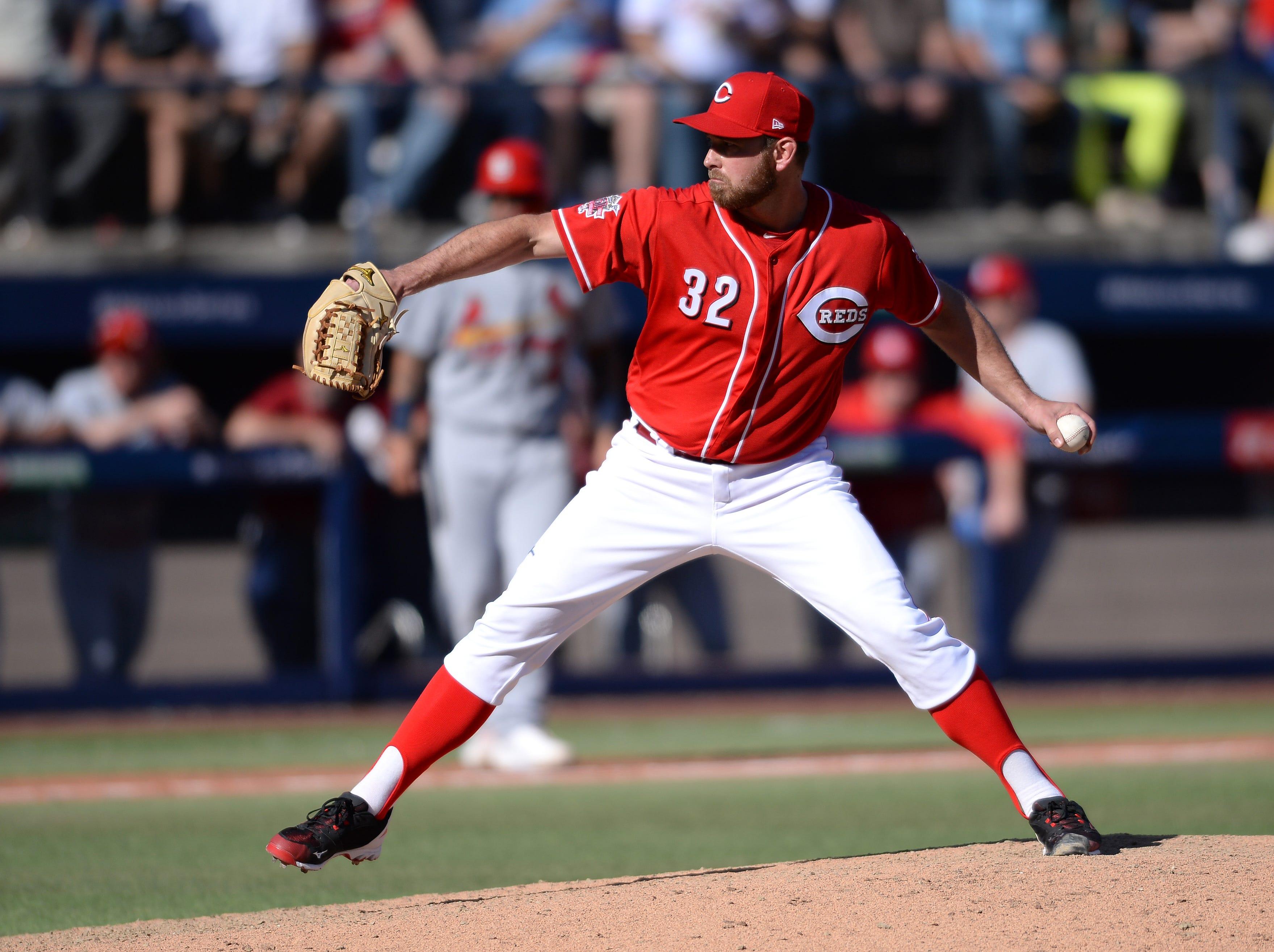 Cincinnati Reds relief pitcher Zach Duke (32) throws against the St. Louis Cardinals during the seventh inning at Estadio de Beisbol Monterrey.