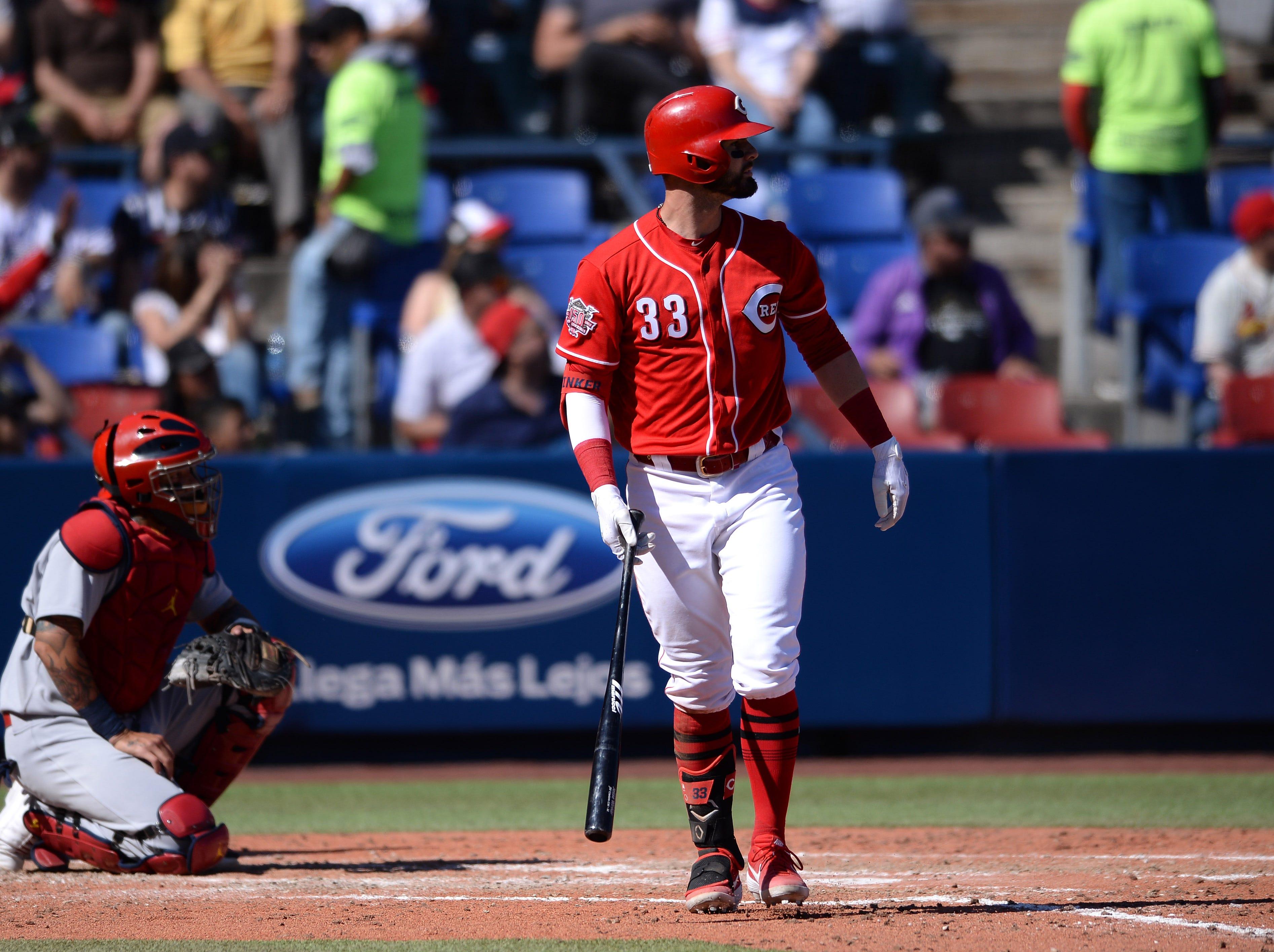 Cincinnati Reds left fielder Jesse Winker (33) hits a three run home run against the St. Louis Cardinals during the fifth inning at Estadio de Beisbol Monterrey.
