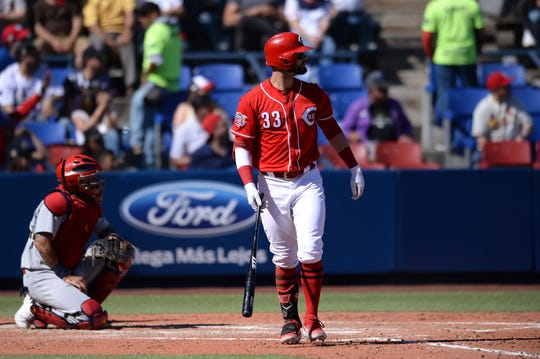 Cincinnati Reds left fielder Jesse Winker (33) hits a three run home run against the St. Louis Cardinals during the fifth inning at Estadio de Beisbol Monterrey.