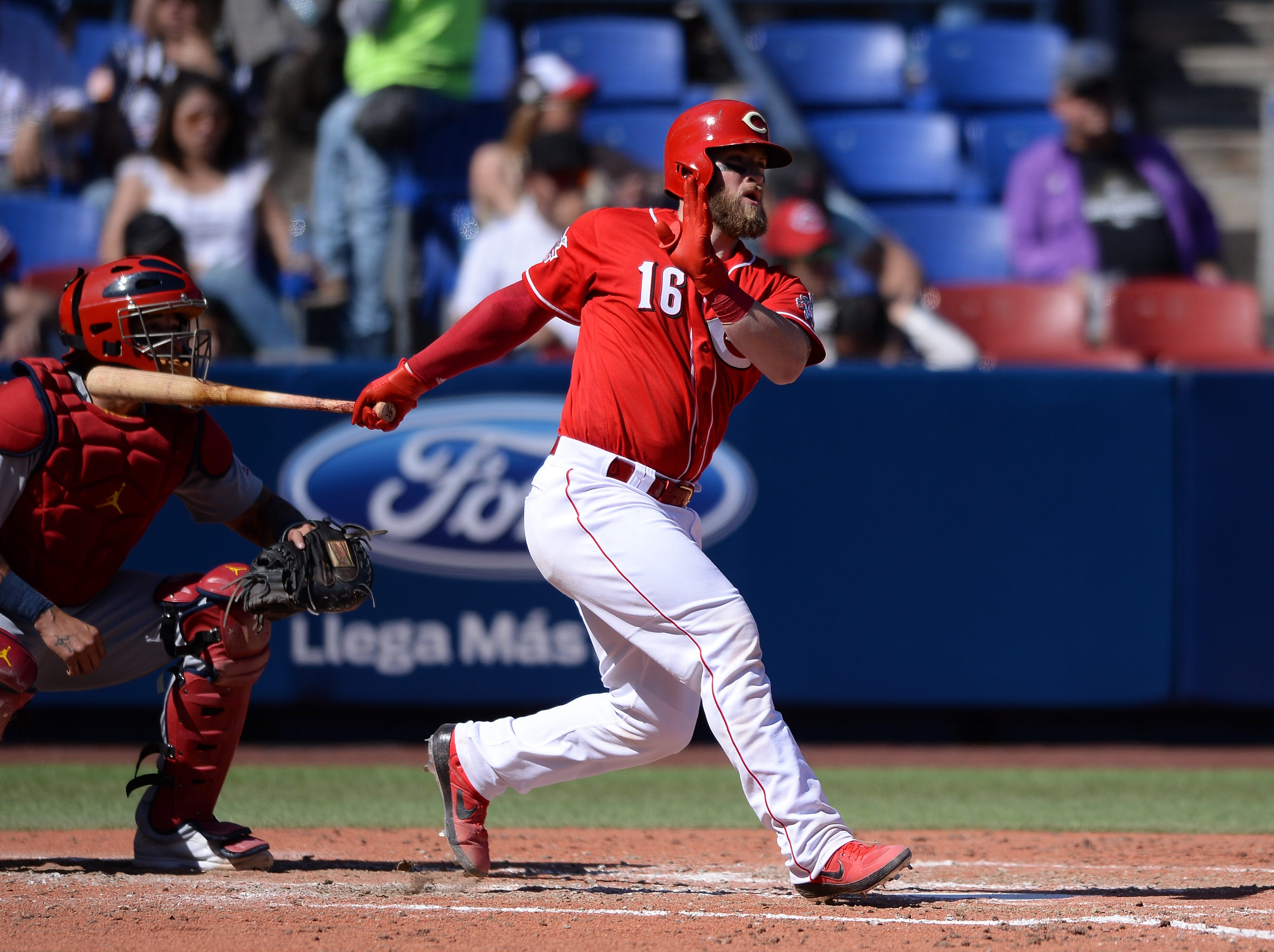 Cincinnati Reds catcher Tucker Barnhart (16) hits a single during the fifth inning against the St. Louis Cardinals at Estadio de Beisbol Monterrey.