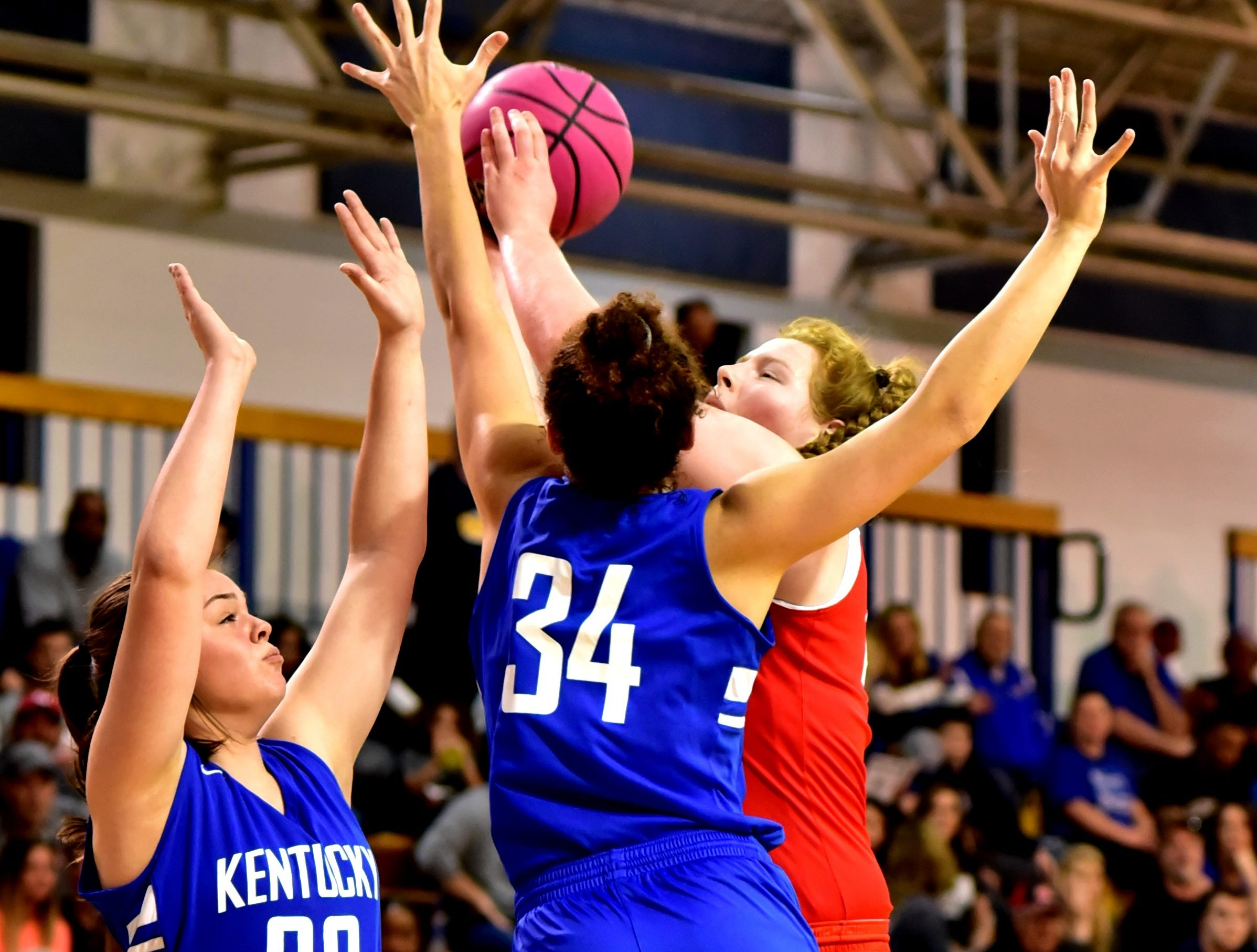 Emma Shaffer (back) of Ursuline Academy puts up a jump shot in traffic for the Ohio girls team at the 28th Annual Ohio-Kentucky All Star Games played at Thomas More University, April 13, 2019