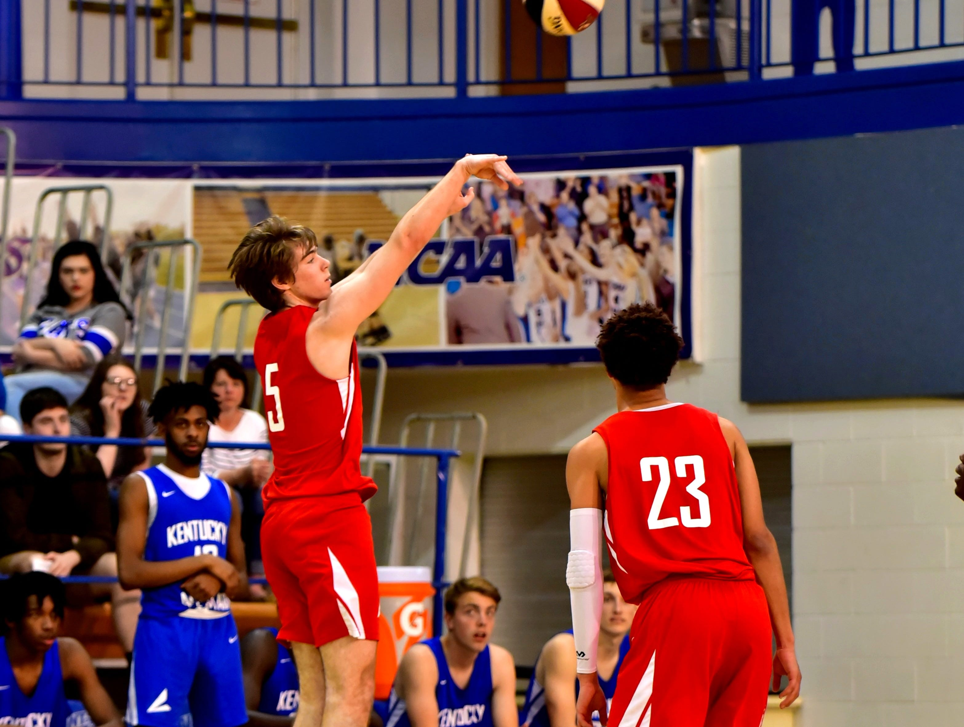 Alec Pfriem of Moeller drains a three pointer for the Ohio boys team in the third quarter at the 28th Annual Ohio-Kentucky All Star Games played at Thomas More University, April 13, 2019