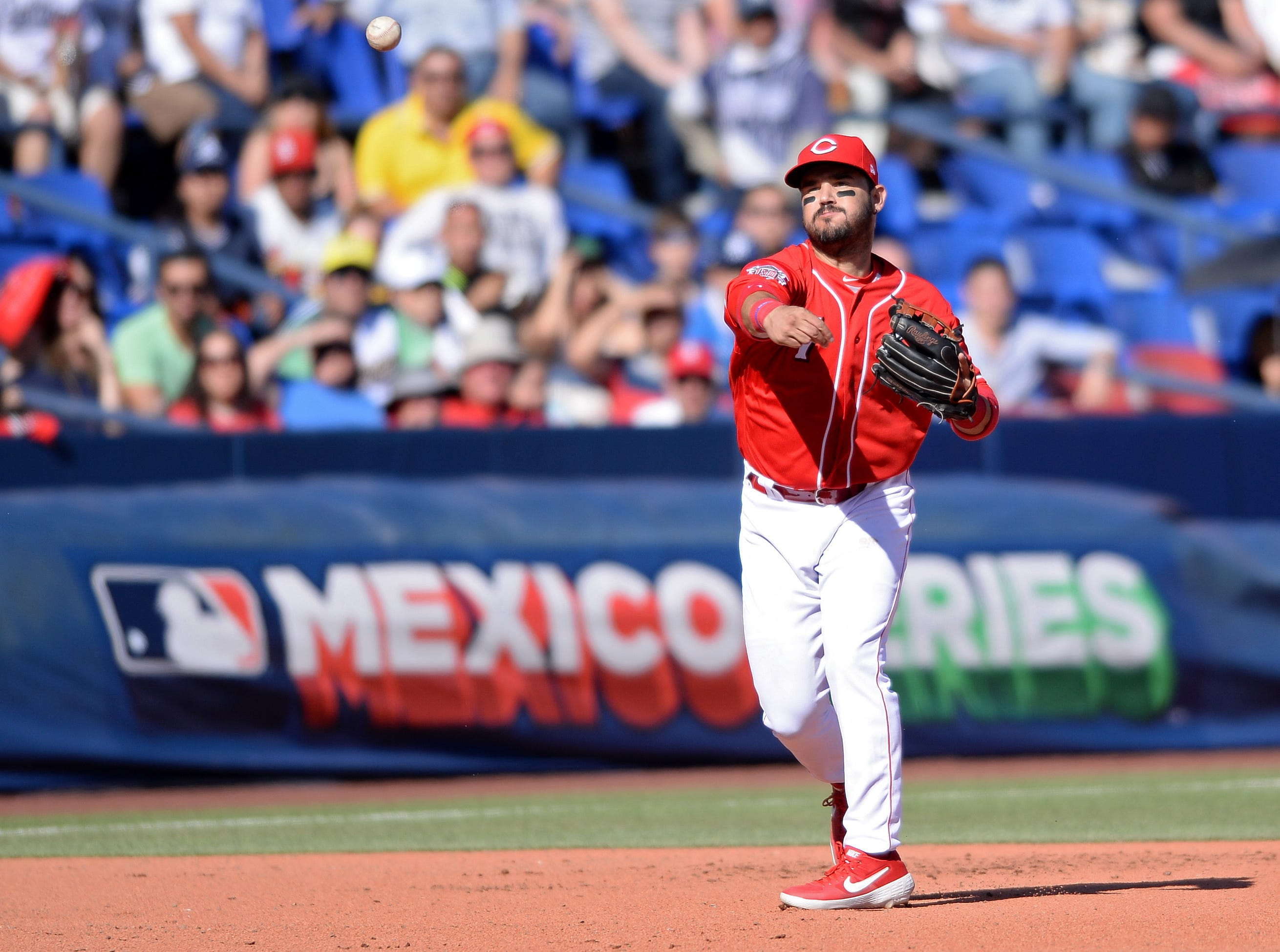 Cincinnati Reds third baseman Eugenio Suarez (7) throws to first base on a ground out by St. Louis Cardinals shortstop Paul DeJong (not pictured) during the seventh inning at Estadio de Beisbol Monterrey.