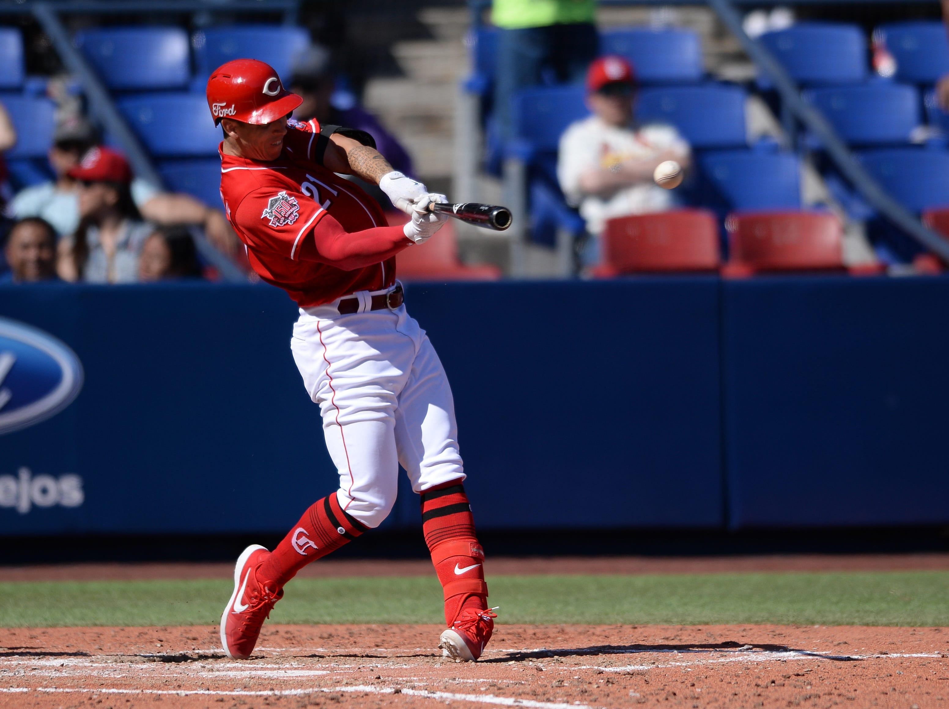 Cincinnati Reds relief pitcher Michael Lorenzen (21) hits an RBI double during the fifth inning against the St. Louis Cardinals at Estadio de Beisbol Monterrey.