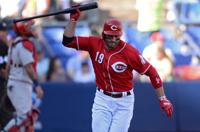 Cincinnati Reds first baseman Joey Votto (19) throws his bat after flying out to St. Louis Cardinals right fielder Tyler O'Neill (not pictured) to end the seventh inning at Estadio de Beisbol Monterrey.