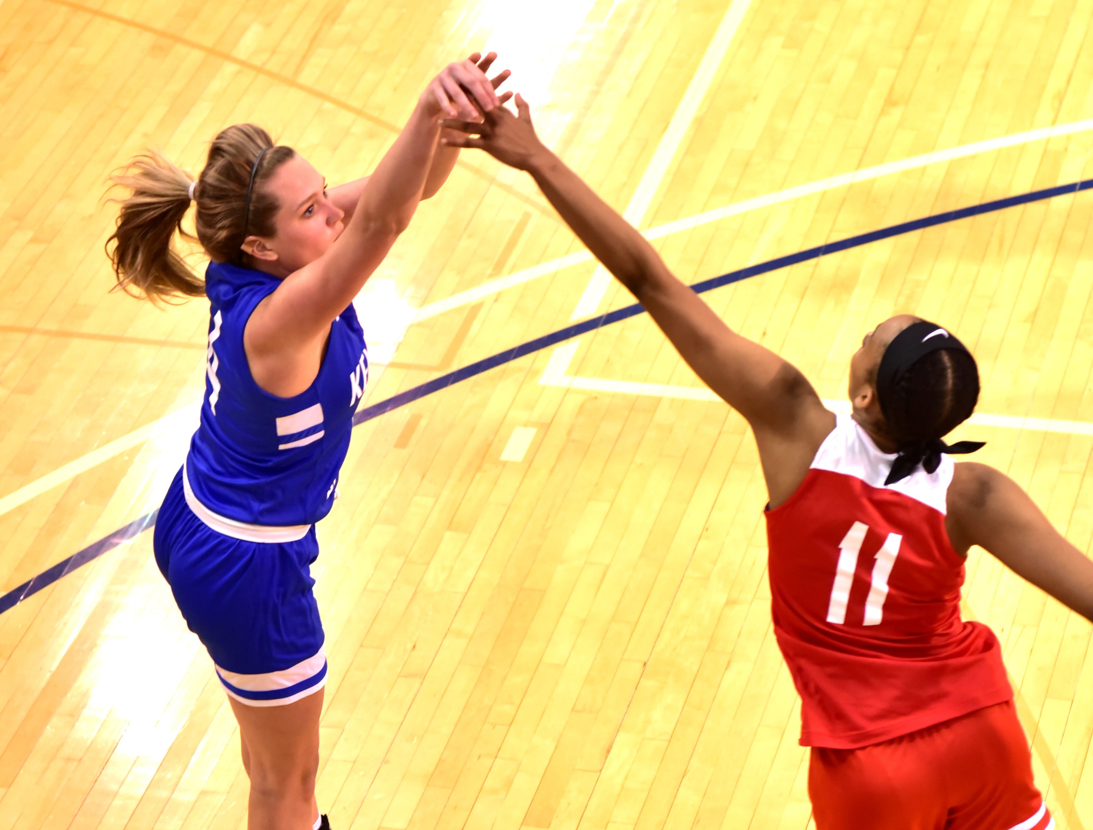 Conner's Courtney Hurst lifts a jump shot for a Kentucky girls team basket over the defense of Dominique Camp of Lakota West at the 28th Annual Ohio-Kentucky All Star Games played at Thomas More University, April 13, 2019