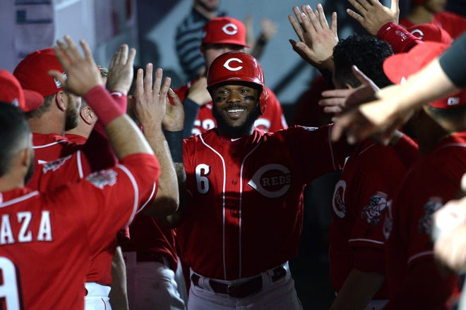 Cincinnati Reds right fielder Phillip Ervin (6) is congratulated in the dugout after scoring on a single by center fielder Scott Schebler (not pictured) during the eighth inning against the St. Louis Cardinals at Estadio de Beisbol Monterrey.