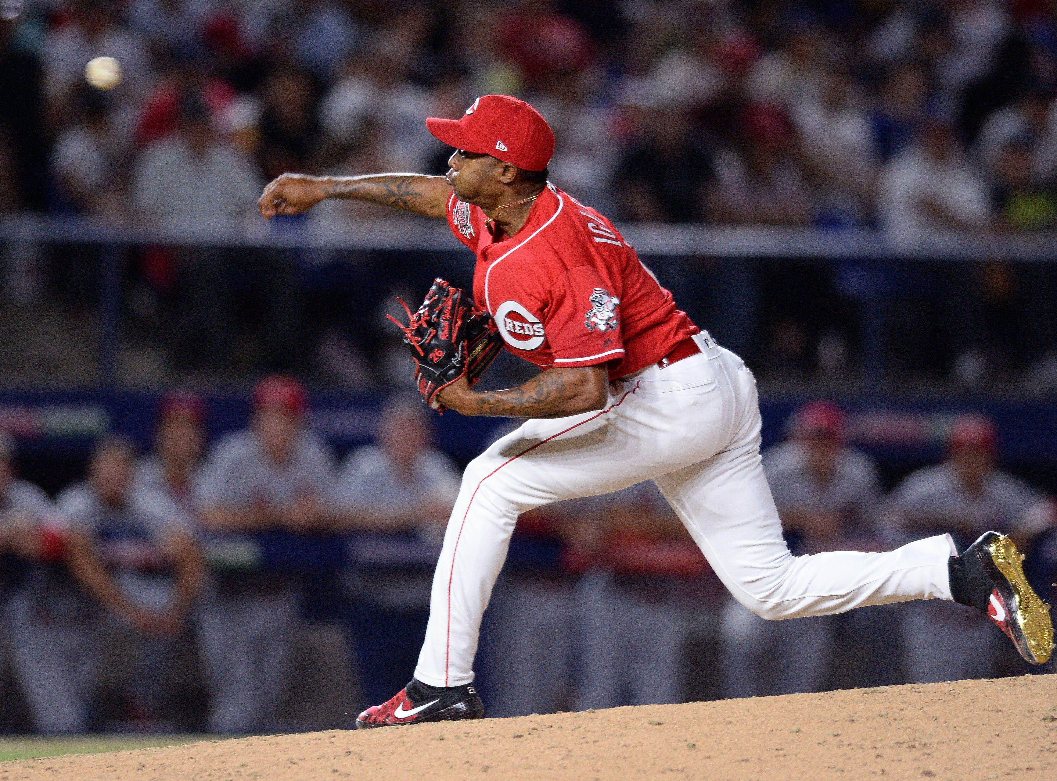 Cincinnati Reds relief pitcher Raisel Iglesias (26) works against a St. Louis Cardinals batter during the ninth inning at Estadio de Beisbol Monterrey.