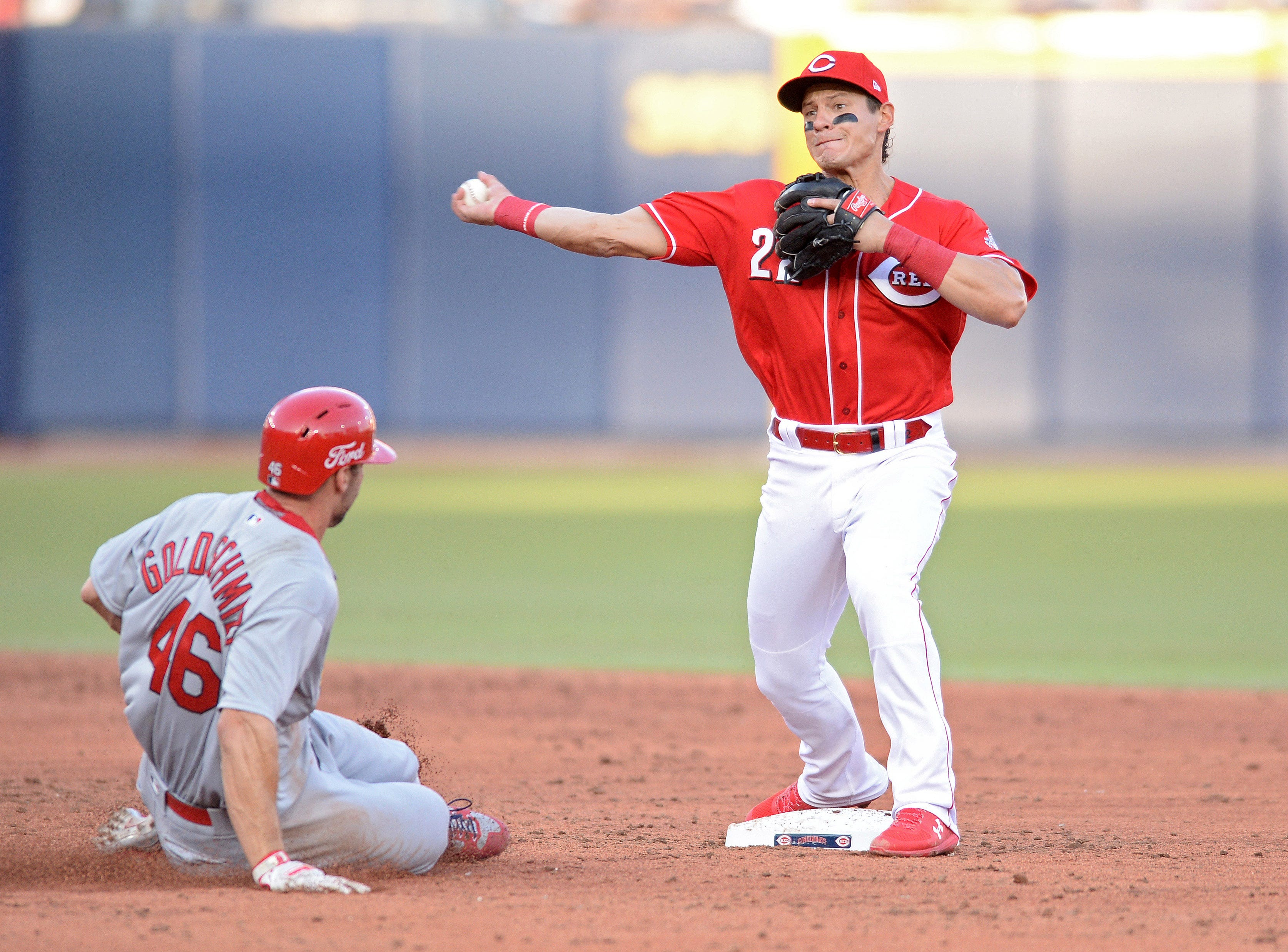Cincinnati Reds second baseman Derek Dietrich (22) forces out St. Louis Cardinals first baseman Paul Goldschmidt (46) at second base before throwing to first base to complete the double play on a ball hit by left fielder Marcell Ozuna (not pictured) during the third inning at Estadio de Beisbol Monterrey.
