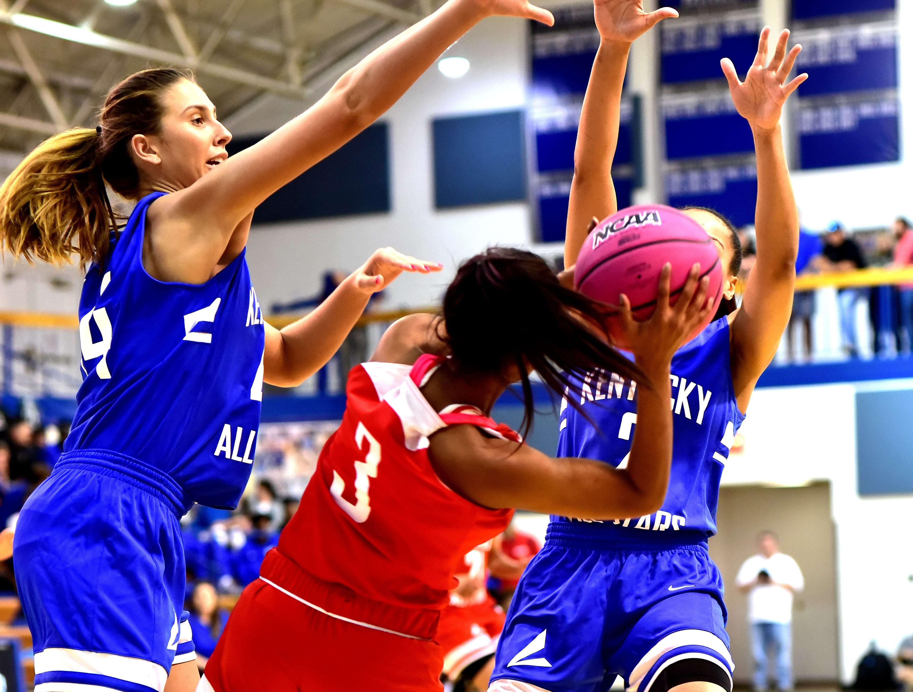 Lakota West's Bryana Henderson (3) is caught in defensive traffic for the Ohio girls team at the 28th Annual Ohio-Kentucky All Star Games played at Thomas More University, April 13, 2019