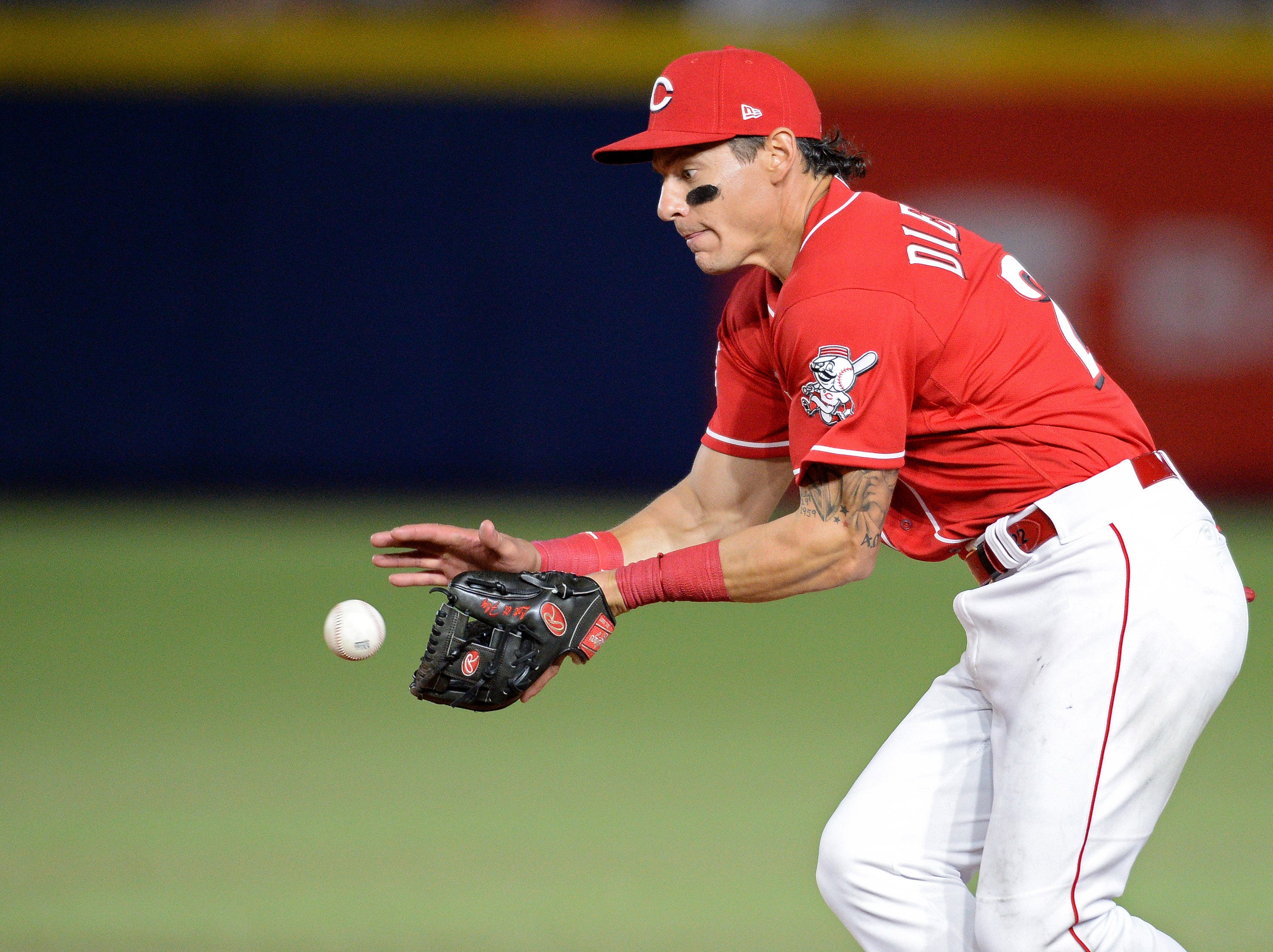 Cincinnati Reds second baseman Derek Dietrich (22) fields deflected ball hit by St. Louis Cardinals catcher Yadier Molina (not pictured) during the eighth inning at Estadio de Beisbol Monterrey.