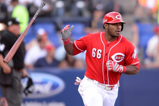 Cincinnati Reds right fielder Yasiel Puig (66) hits a home run during the eighth inning against the St. Louis Cardinals at Estadio de Beisbol Monterrey.