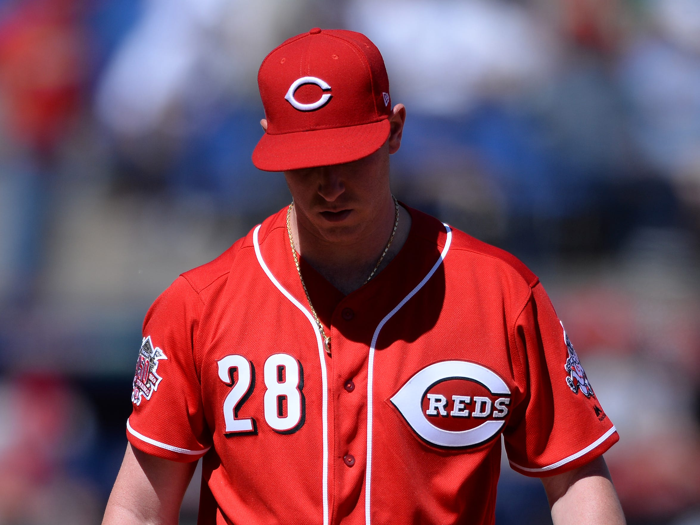 Cincinnati Reds starting pitcher Anthony DeSclafani (28) walks to the dugout after the third out of the top of the fourth inning against the St. Louis Cardinals at Estadio de Beisbol Monterrey.