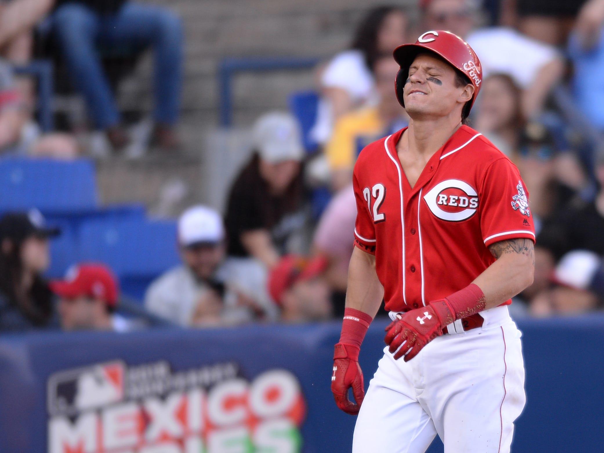 Cincinnati Reds second baseman Derek Dietrich (22) reacts after being hit by a pitch during the eight inning against the St. Louis Cardinals at Estadio de Beisbol Monterrey.