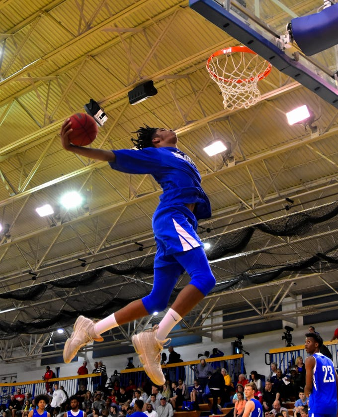 Dieonte Miles of Walton-Verona takes to the air for a throw down during the boys pregame warmups at the 28th Annual Ohio-Kentucky All Star Games played at Thomas More University, April 13, 2019