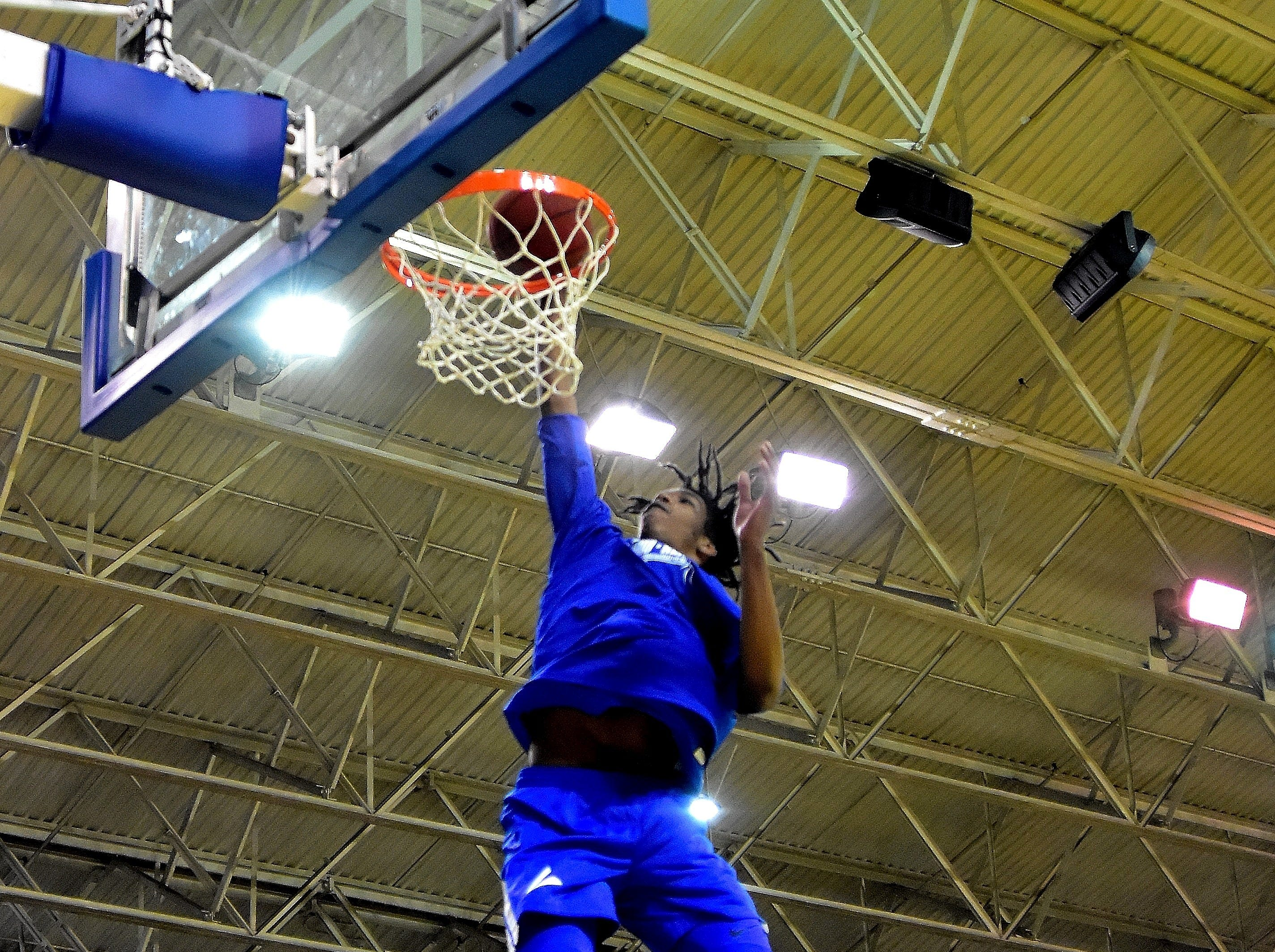 Walton-Verona's Dieonte Miles finishes off a slam dunk buring the boys warmups at the 28th Annual Ohio-Kentucky All Star Games played at Thomas More University, April 13, 2019