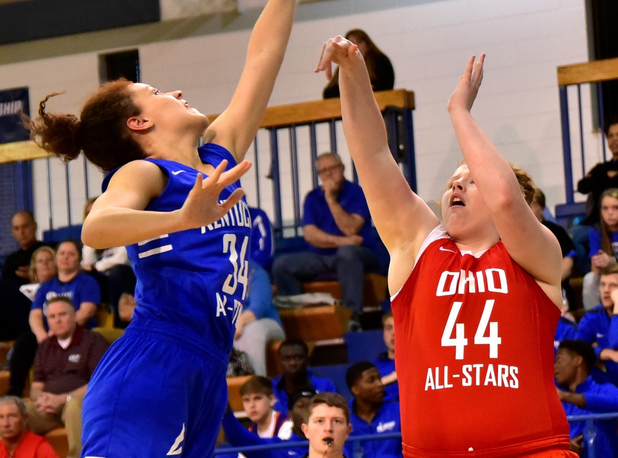 Cameron Browning of Male snuffs out Ursuline Academy's Emma Shaffer's (44) jump shot in the first half at the 28th Annual Ohio-Kentucky All Star Games played at Thomas More University, April 13, 2019