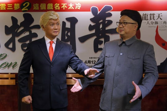 """In this March 1, 2019, file photo, Hong Kong actors Chan Hung-chun, right, and Lung Koon-tin, dressed as North Korean leader Kim Jong Un and U.S. President Donald Trump, pose during a press conference to promote their upcoming Chinese opera """"Trump on Show"""" in Hong Kong."""