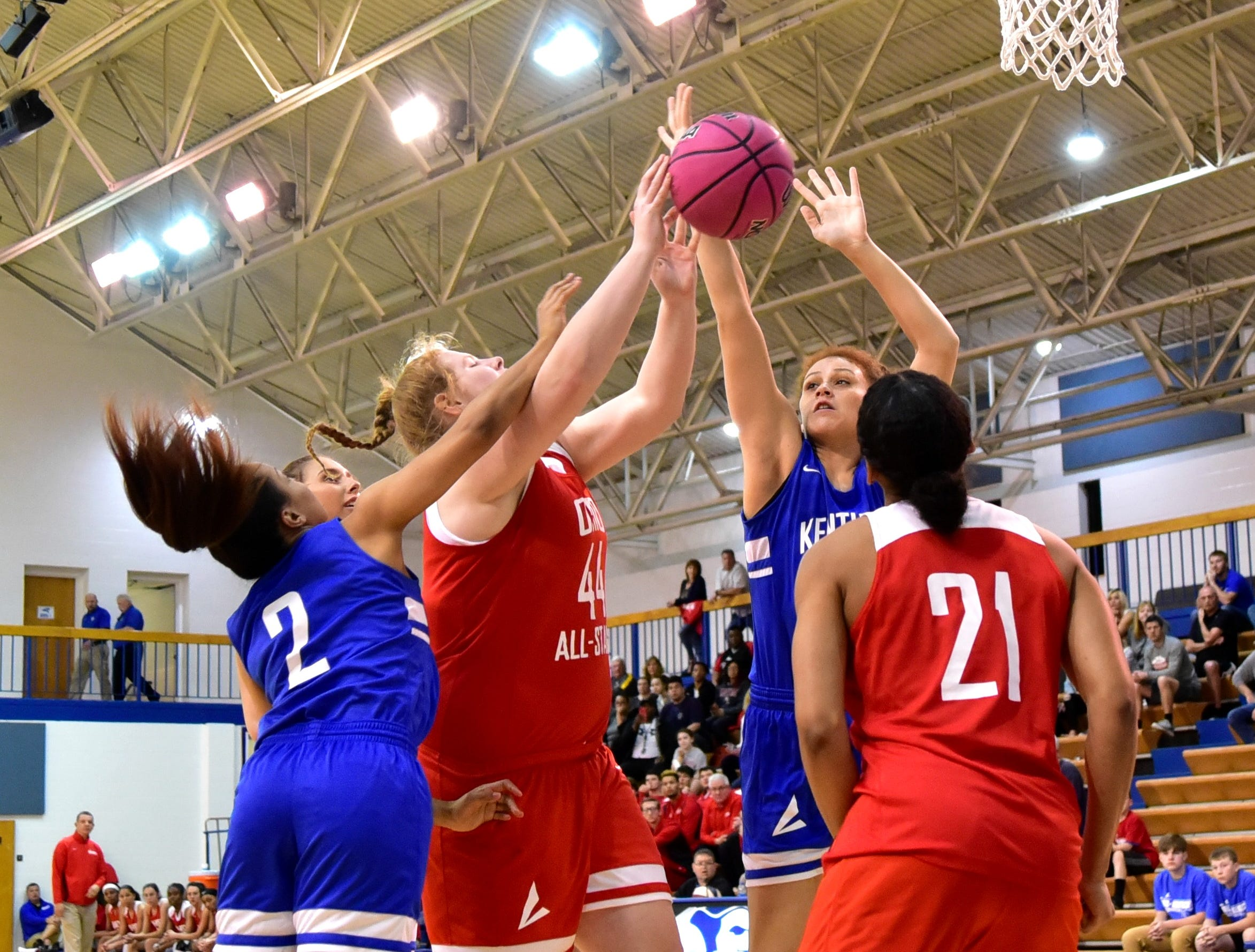 Emma Shaffer (44) of Ursuline Academy puts back an offensive rebound for the Ohio girls team at the 28th Annual Ohio-Kentucky All Star Games played at Thomas More University, April 13, 2019