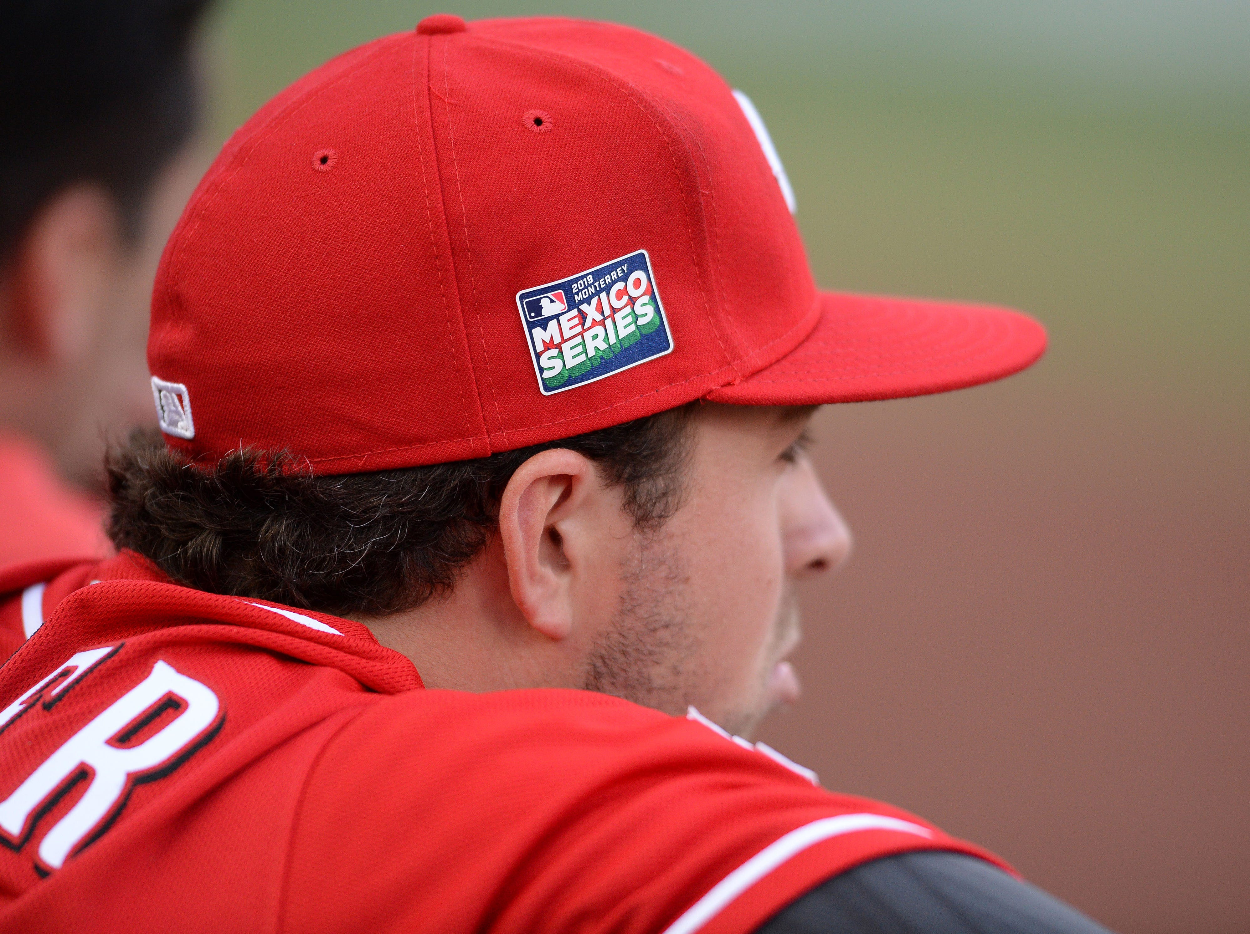 A detailed view of the Mexico Series hat worn by Cincinnati Reds catcher Kyle Farmer during the fourth inning of the game against the St. Louis Cardinals at Estadio de Beisbol Monterrey.