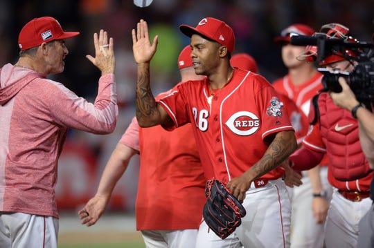 Cincinnati Reds relief pitcher Raisel Iglesias (26) celebrates after defeating the St. Louis Cardinals 5-2 at Estadio de Beisbol Monterrey.
